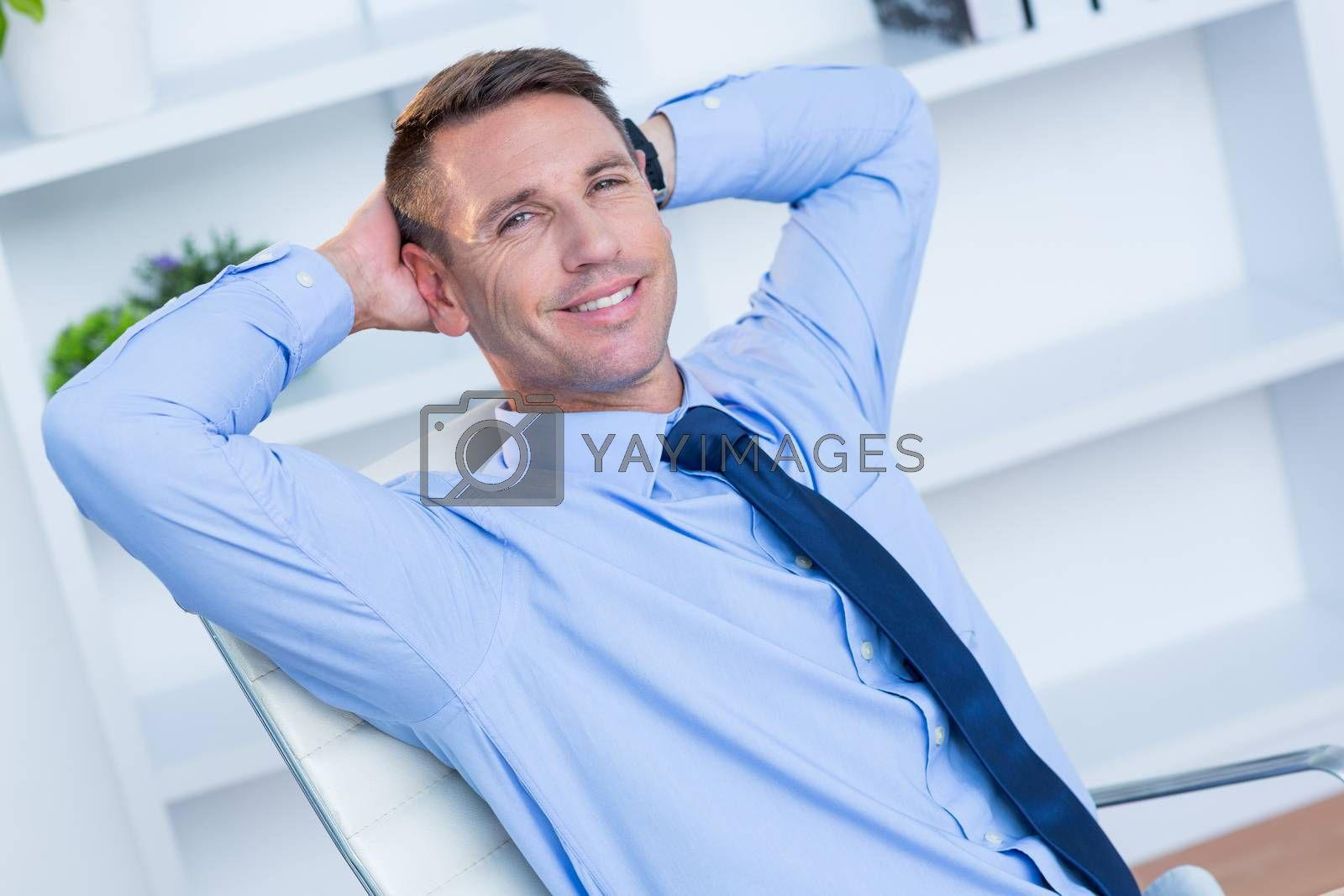 Royalty free image of Portrait of a smiling businessman by Wavebreakmedia