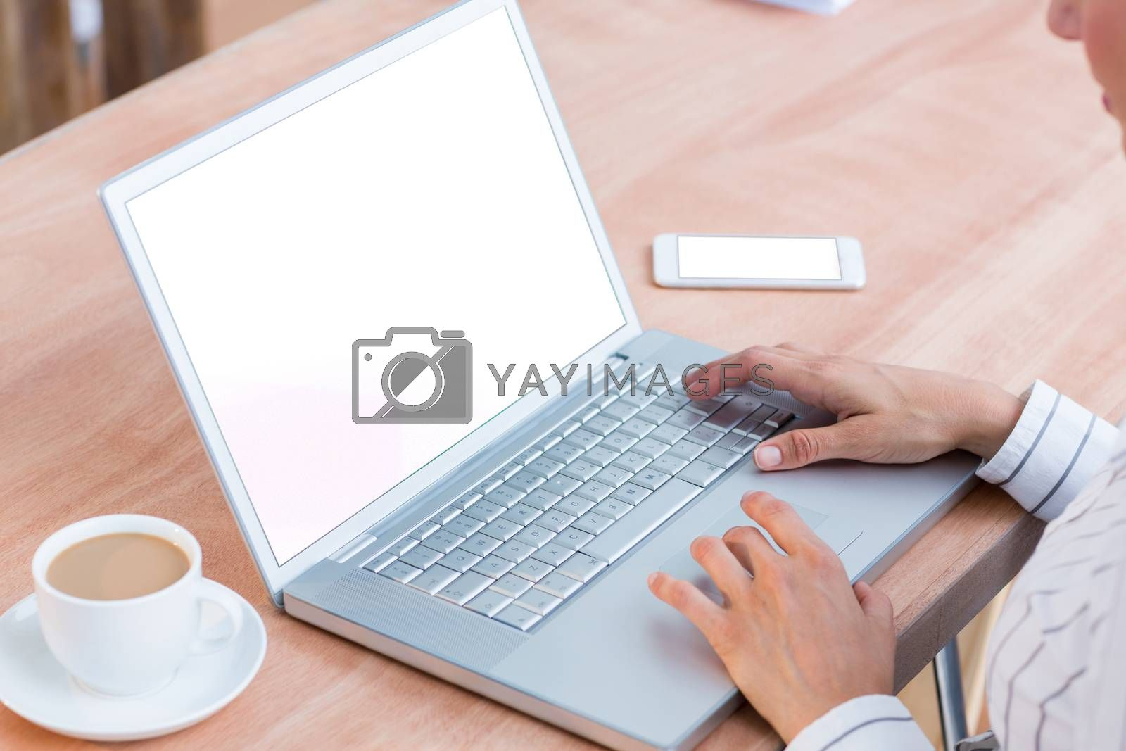 Royalty free image of A businesswoman using her laptop  by Wavebreakmedia