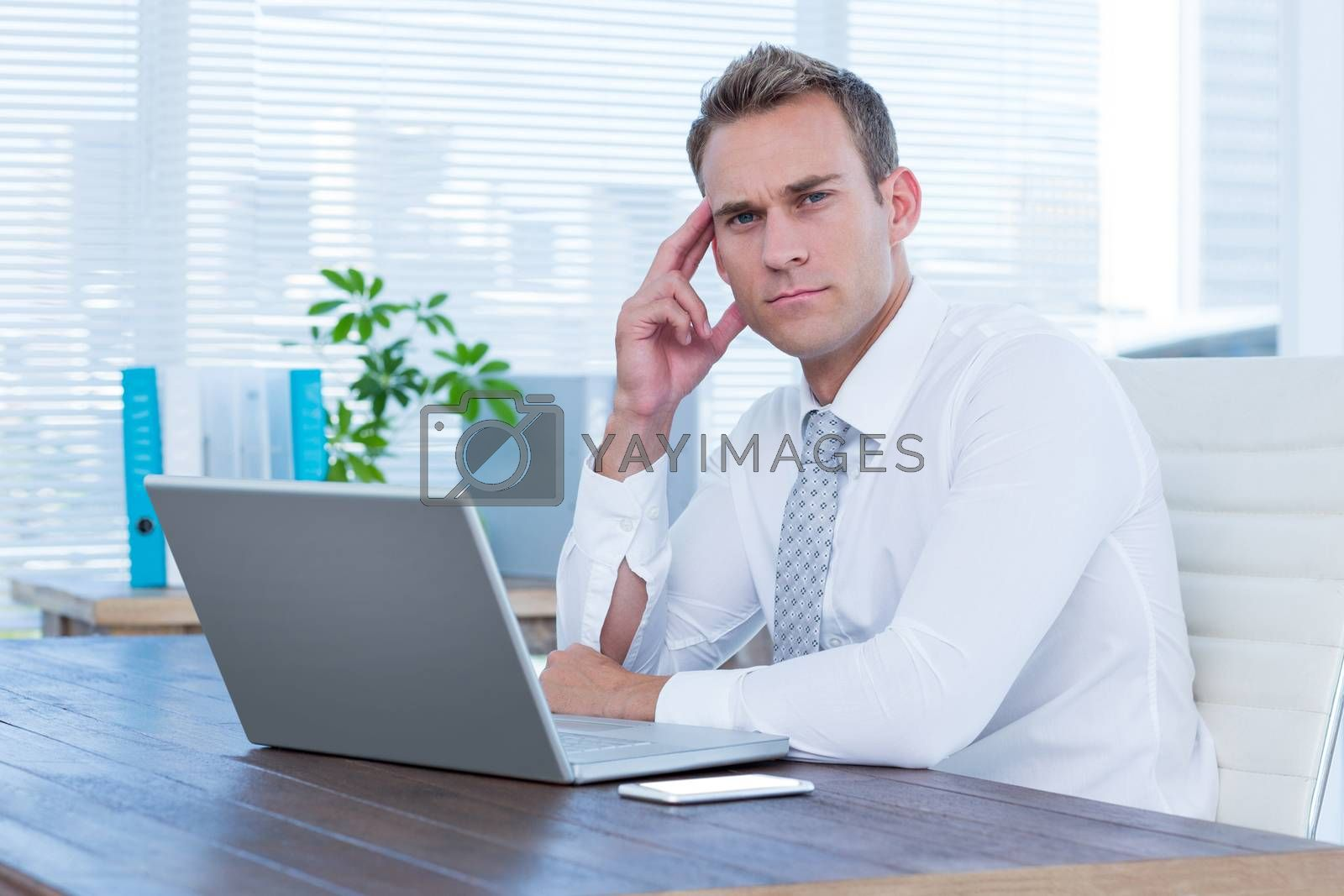 Royalty free image of Focused businessman looking at the camera by Wavebreakmedia