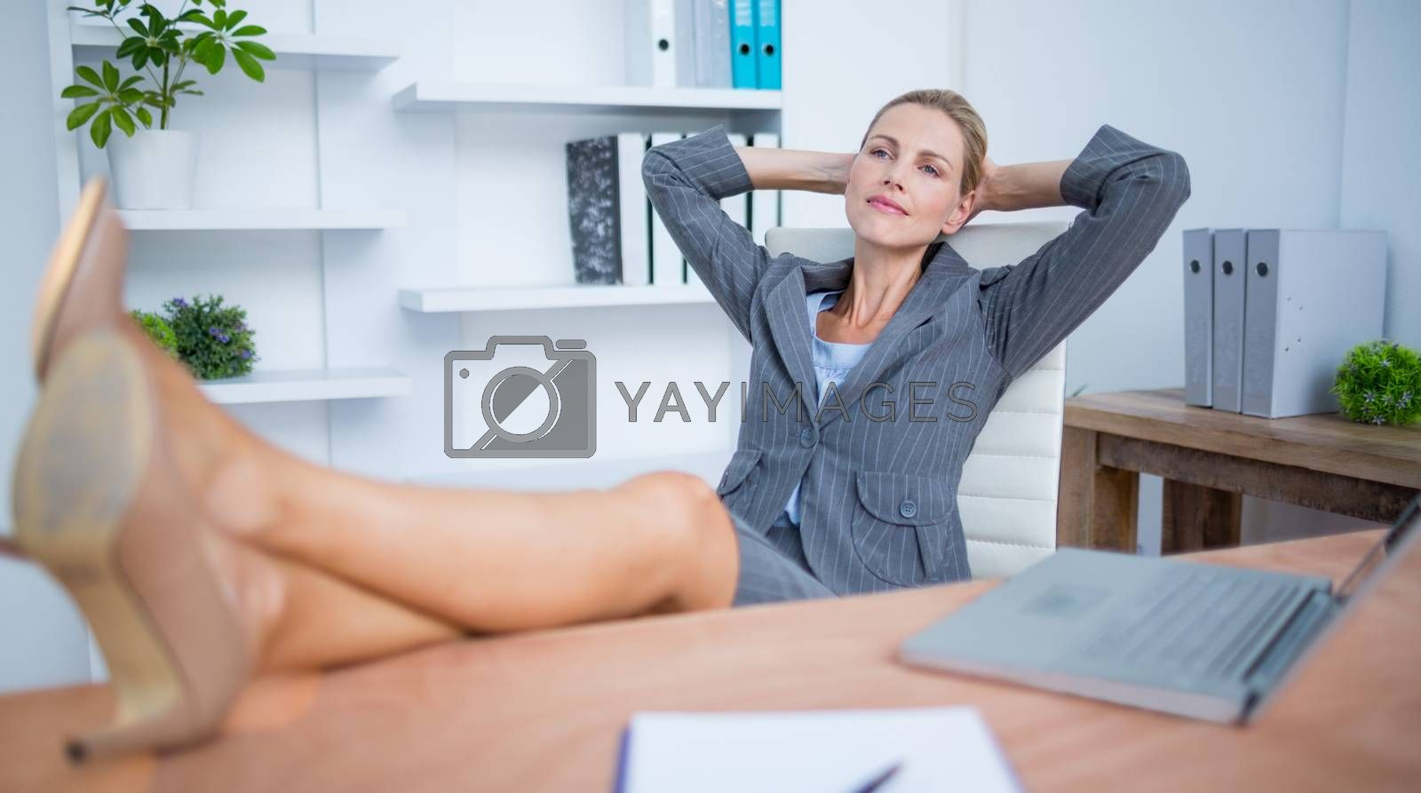 Royalty free image of Pretty blonde businesswoman relaxing herself by Wavebreakmedia