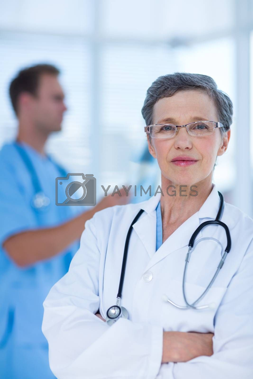 Royalty free image of Attentive doctor looking at the camera by Wavebreakmedia