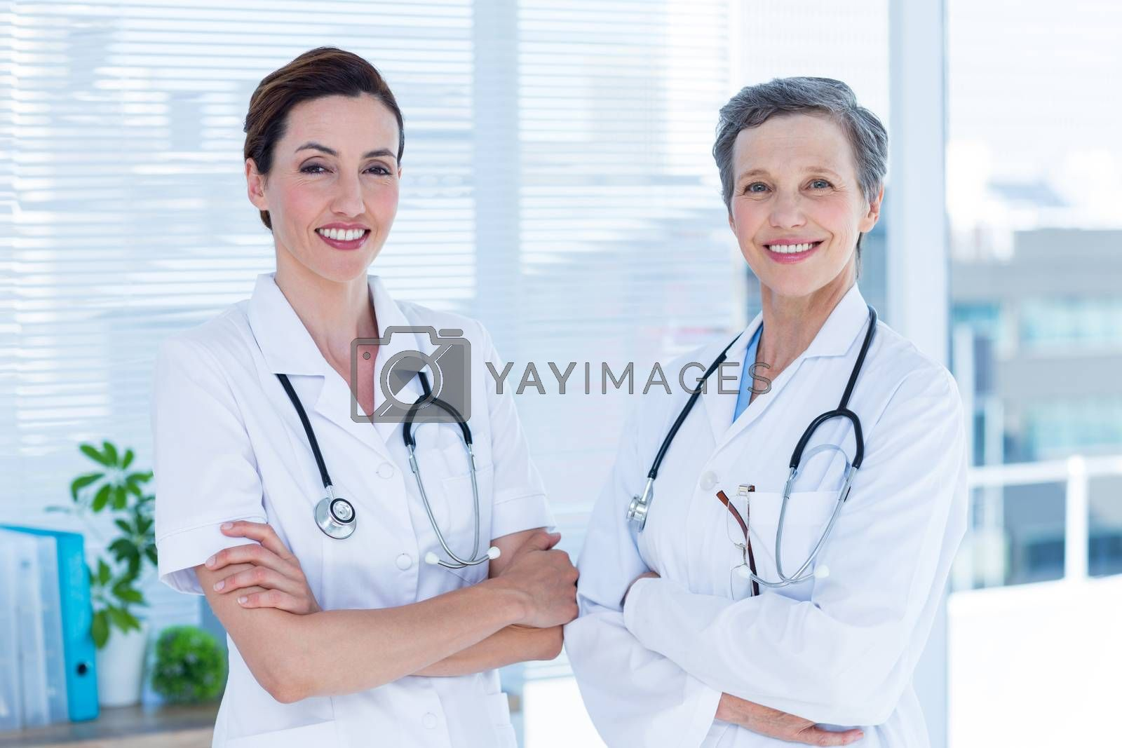 Royalty free image of Portrait of smiling medical colleagues with arms crossed by Wavebreakmedia