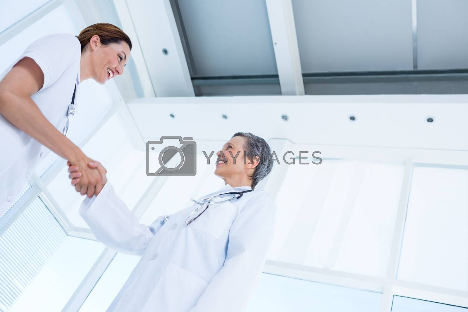 Royalty free image of Smiling medical colleagues shaking hands by Wavebreakmedia