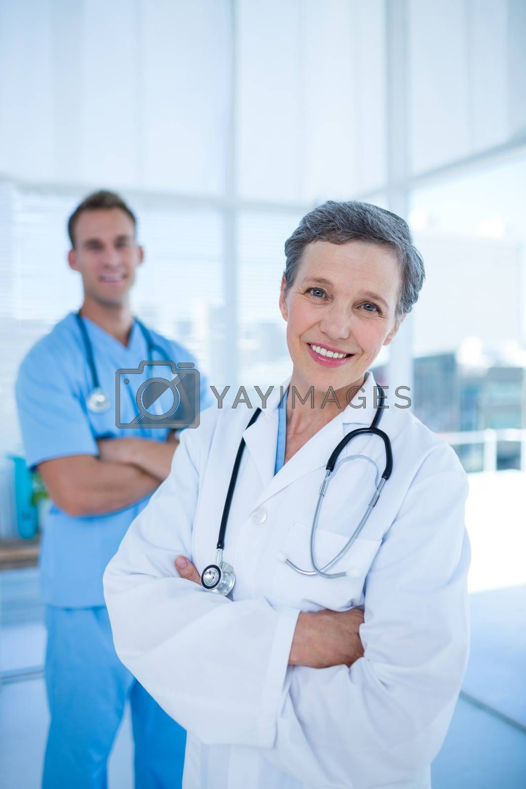 Royalty free image of Smiling colleagues doctors looking at the camera by Wavebreakmedia