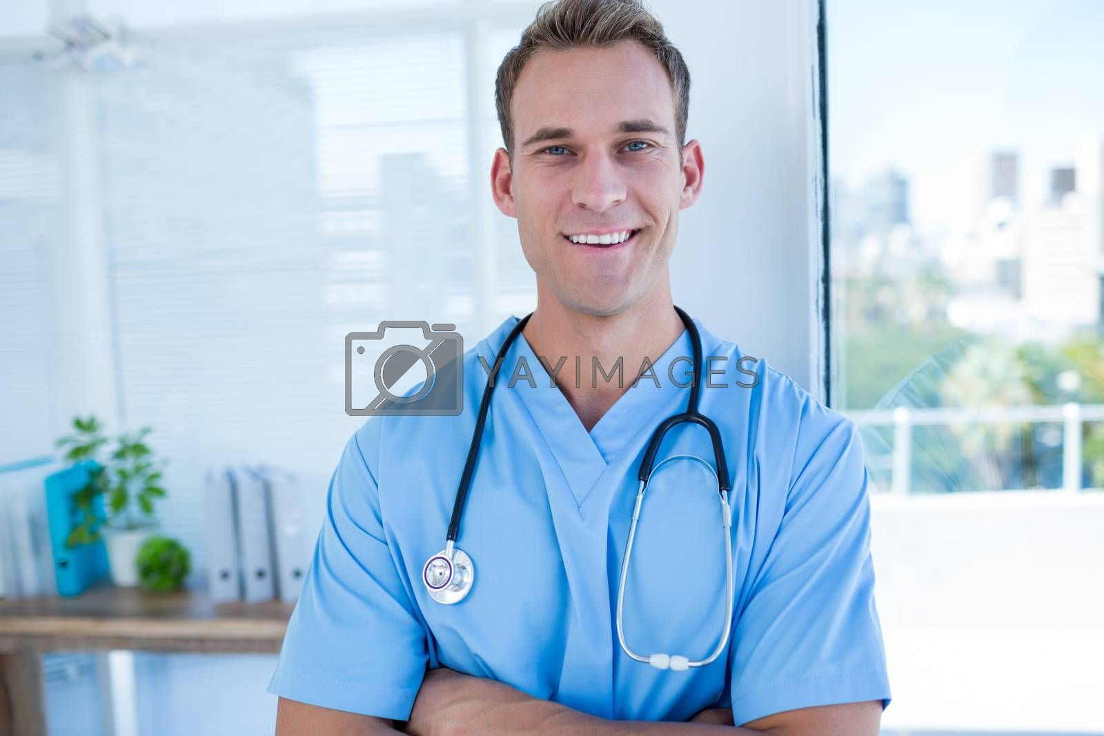 Royalty free image of Smiling doctor looking at the camera by Wavebreakmedia
