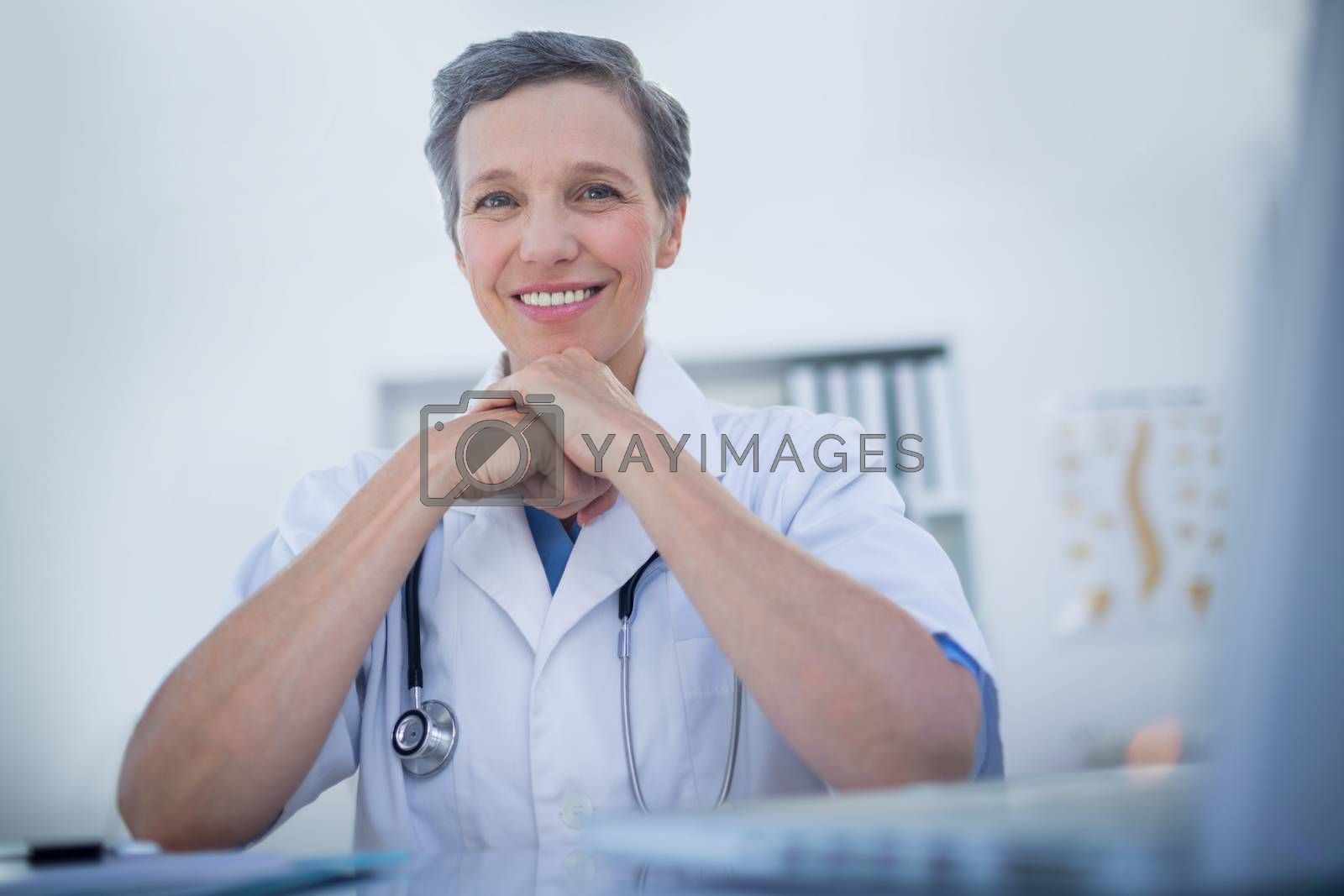 Royalty free image of Happy female doctor looking at camera  by Wavebreakmedia