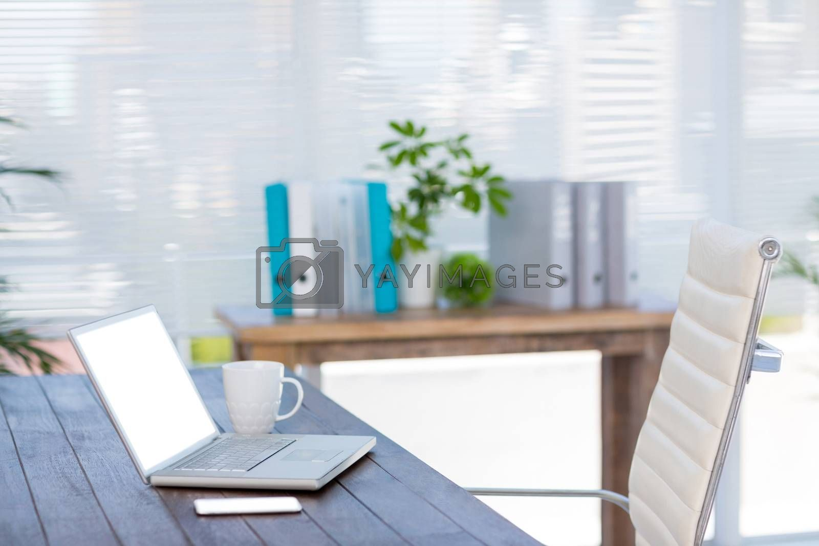 Royalty free image of Business desk with laptop and smartphone by Wavebreakmedia