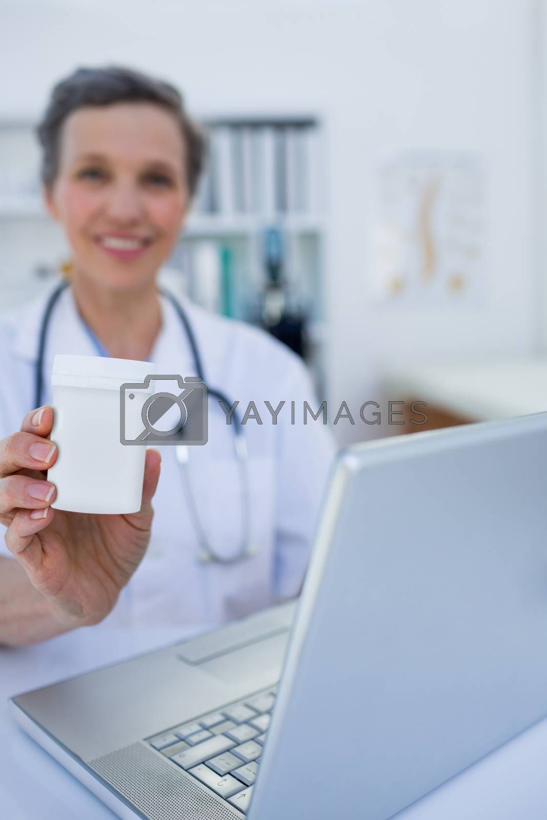Royalty free image of Female doctor holding a box of pills  by Wavebreakmedia
