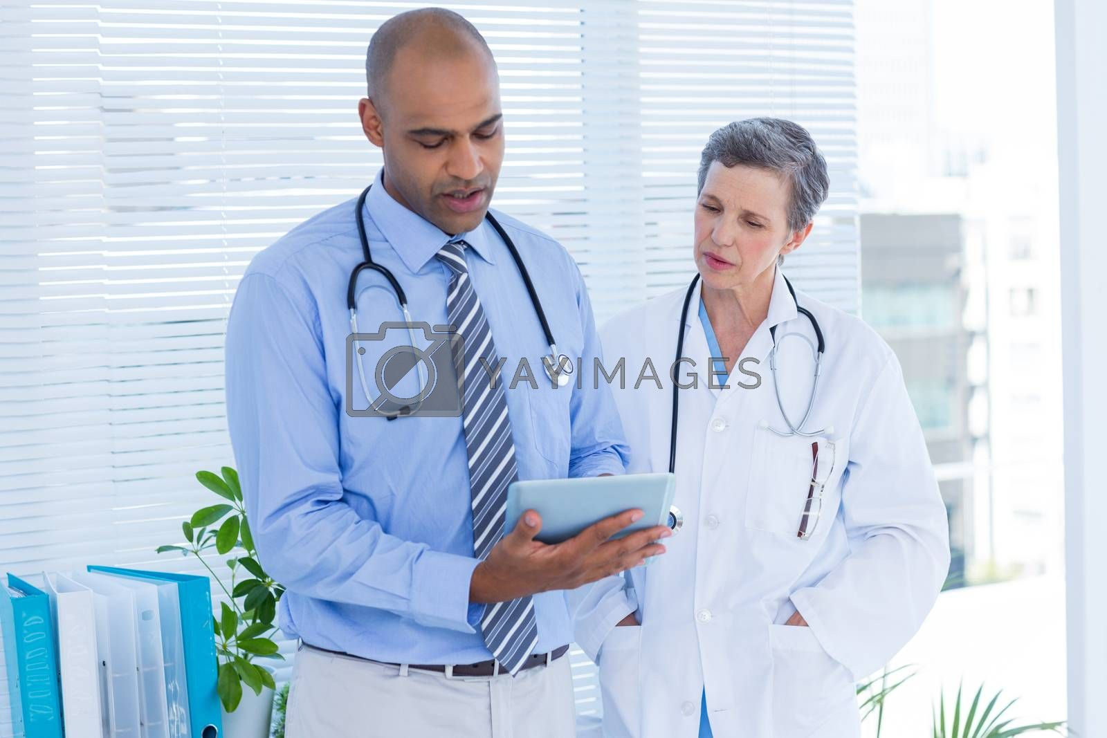 Royalty free image of Medical colleagues working with tablet computer by Wavebreakmedia