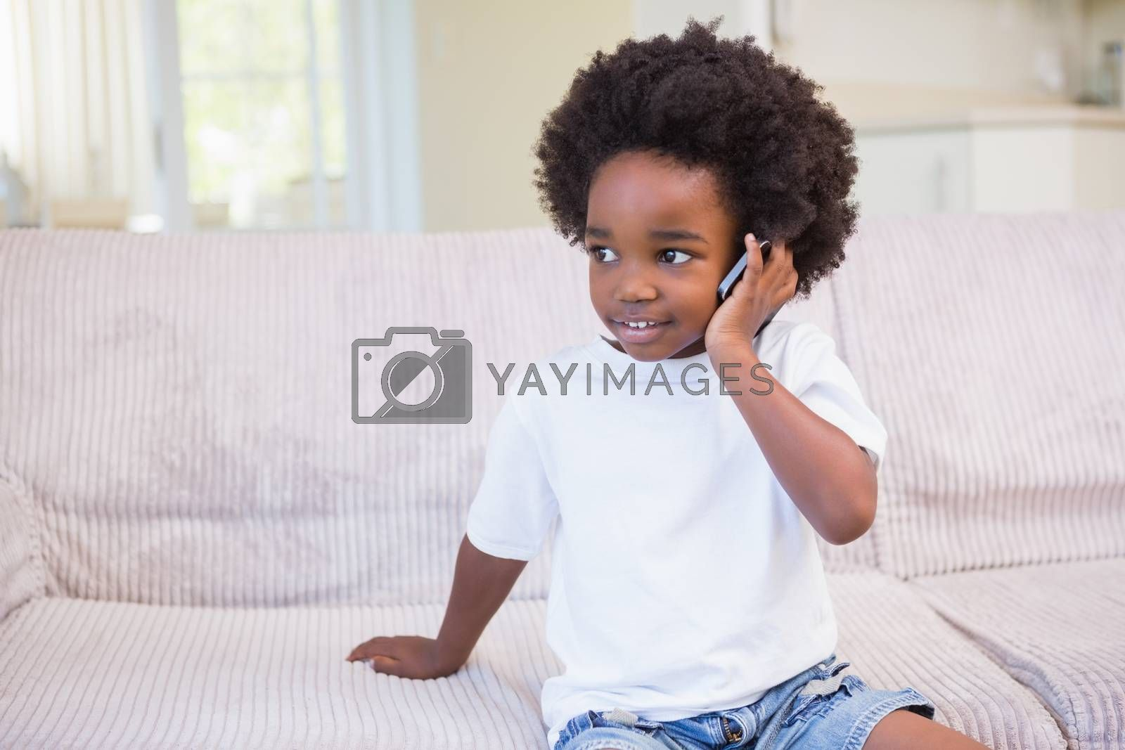 Royalty free image of Little boy using a technology and phoning by Wavebreakmedia