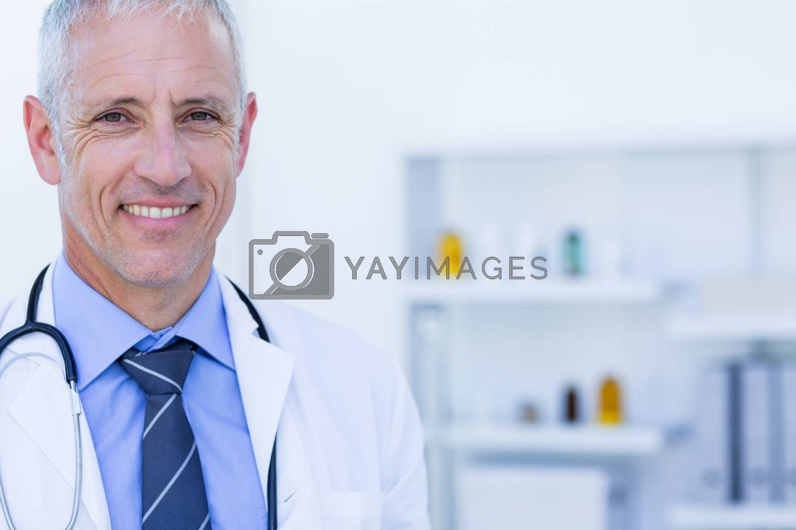 Royalty free image of Happy doctor looking at camera  by Wavebreakmedia