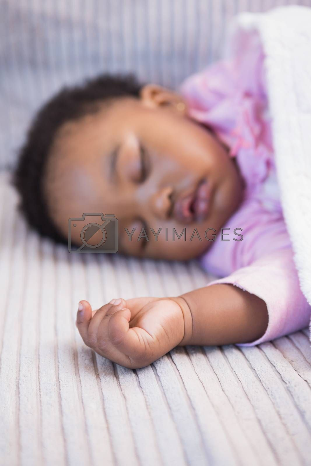 Royalty free image of Little girl sleeping on the sofa by Wavebreakmedia