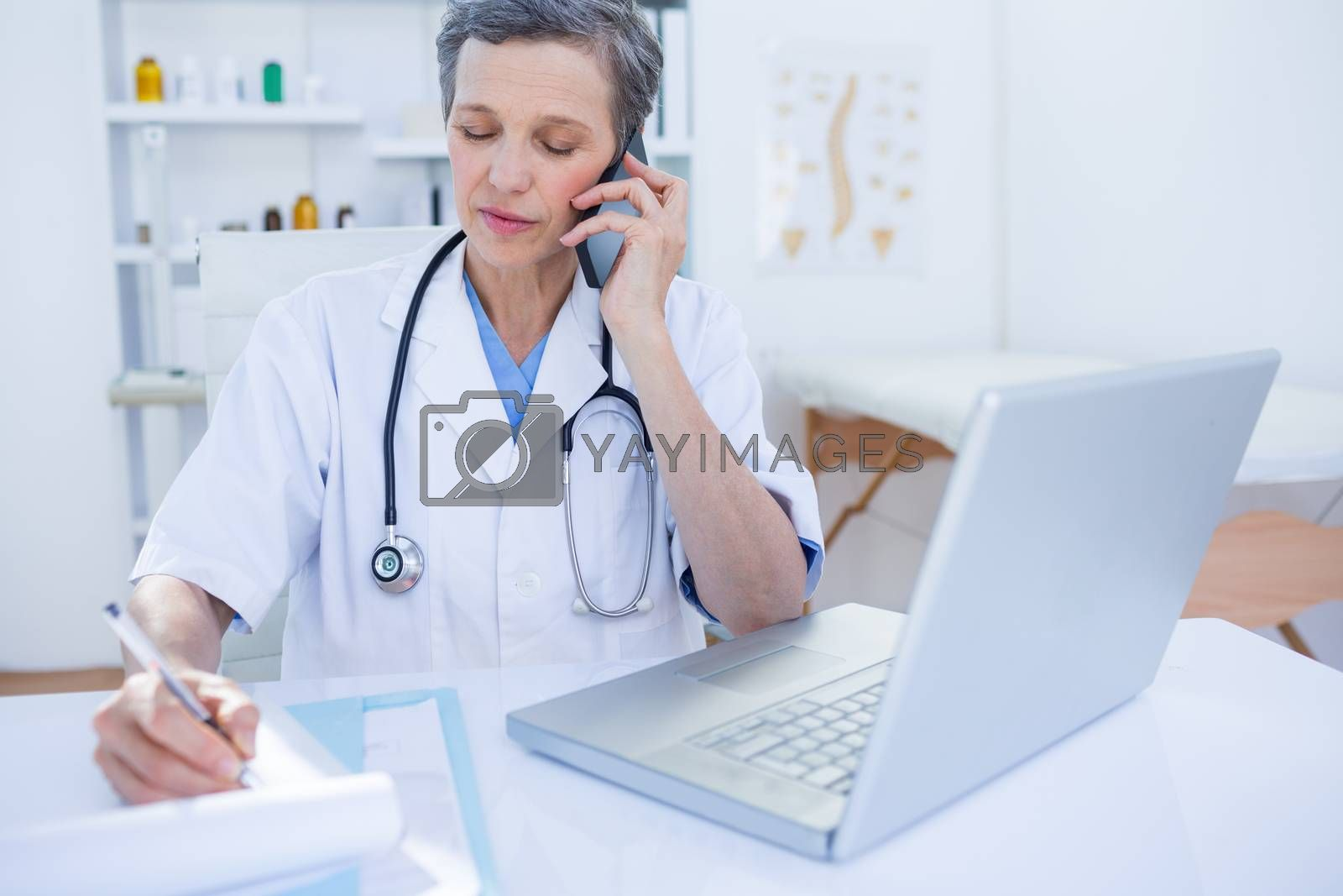 Royalty free image of Female doctor having a phone call by Wavebreakmedia