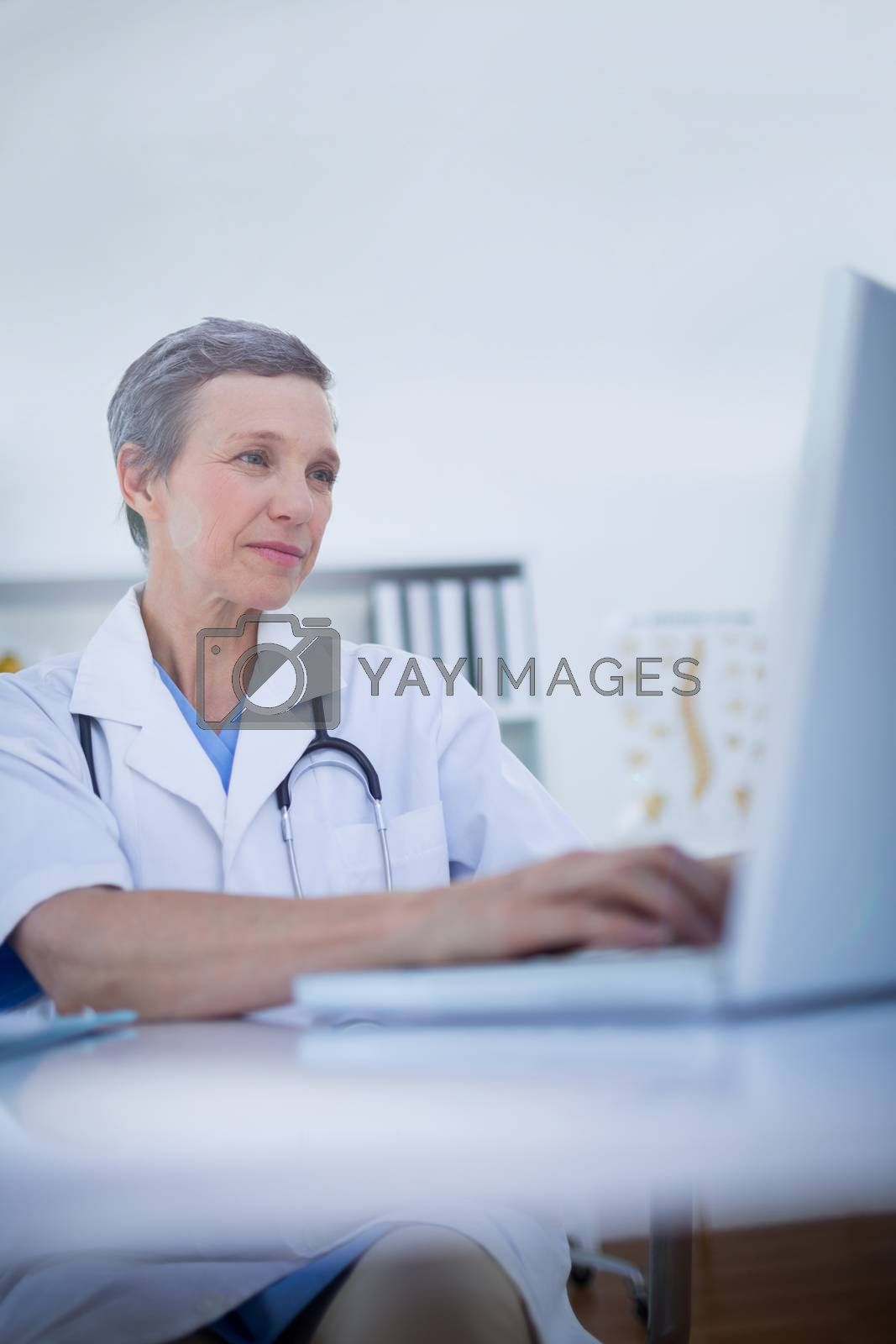 Royalty free image of Female doctor using her laptop computer  by Wavebreakmedia