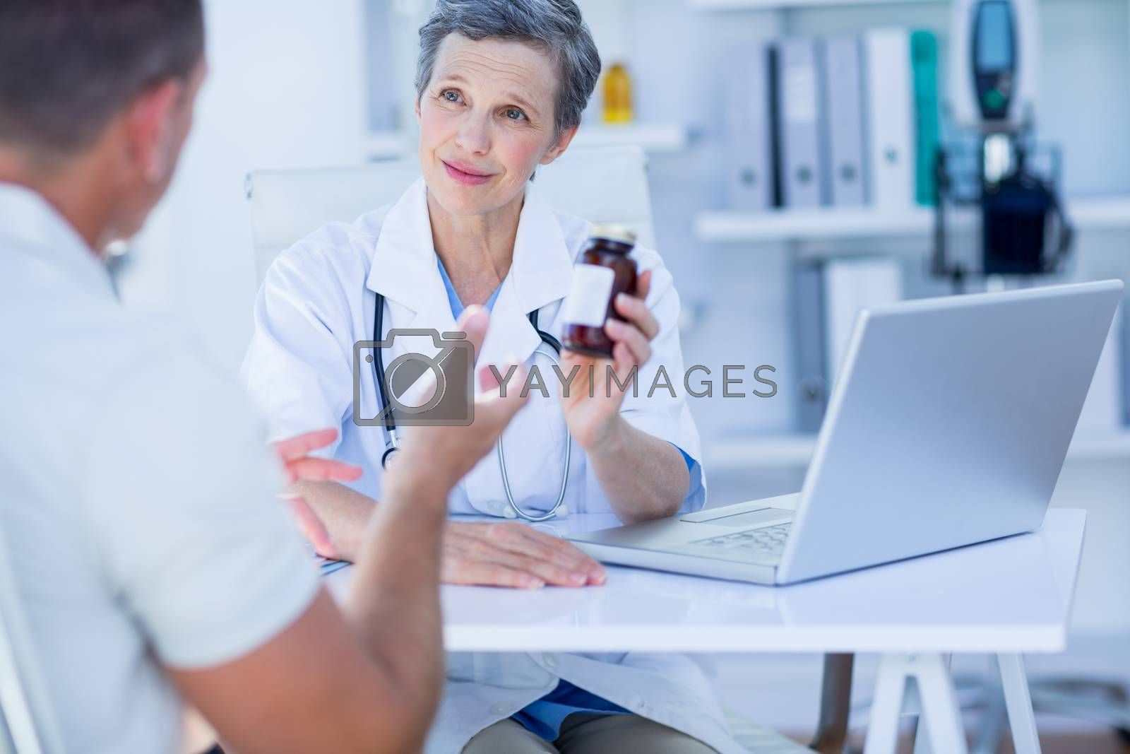 Royalty free image of Female doctor giving a box of pills to her patient  by Wavebreakmedia