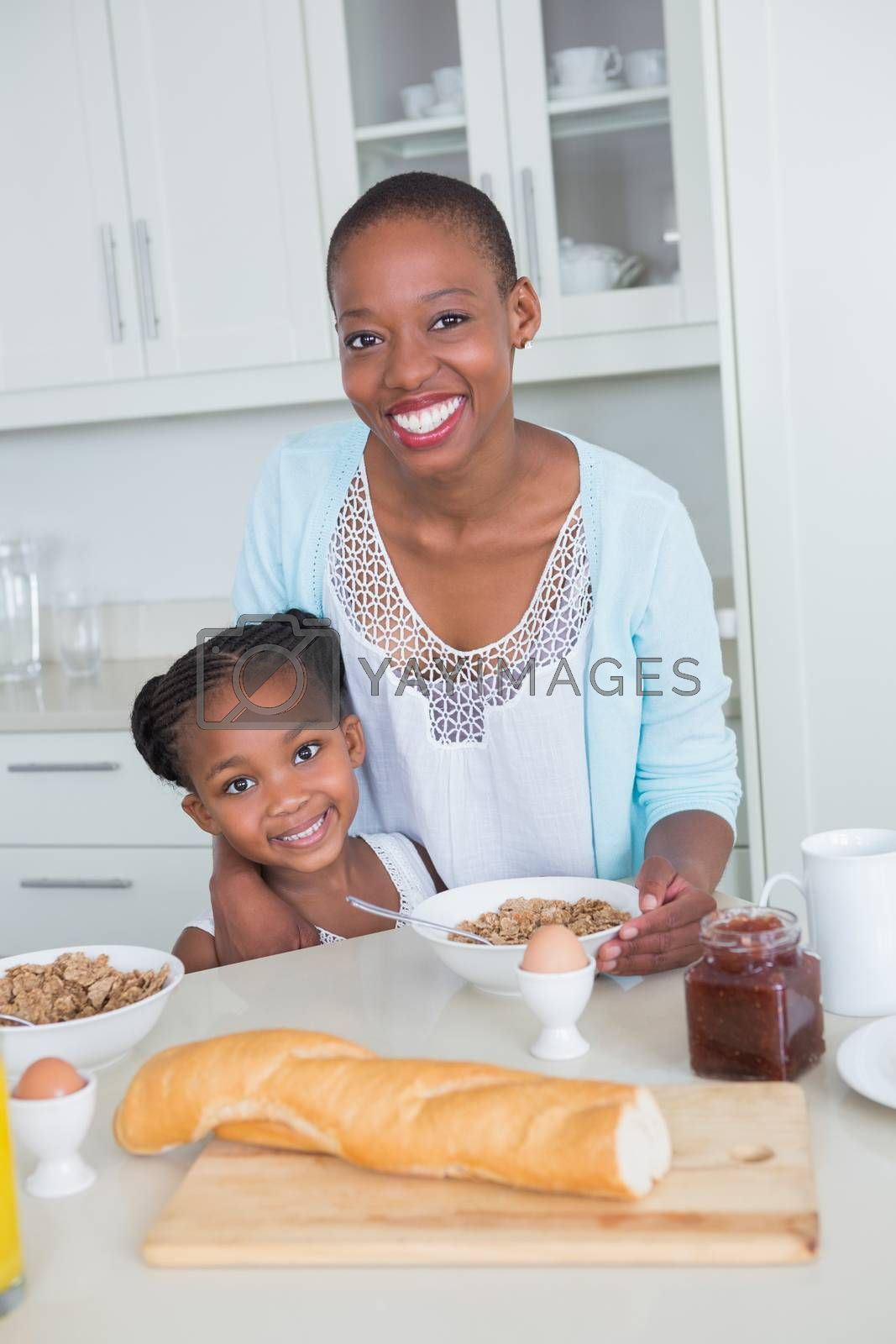 Royalty free image of Portrait smiling mother and daughter eating together  by Wavebreakmedia