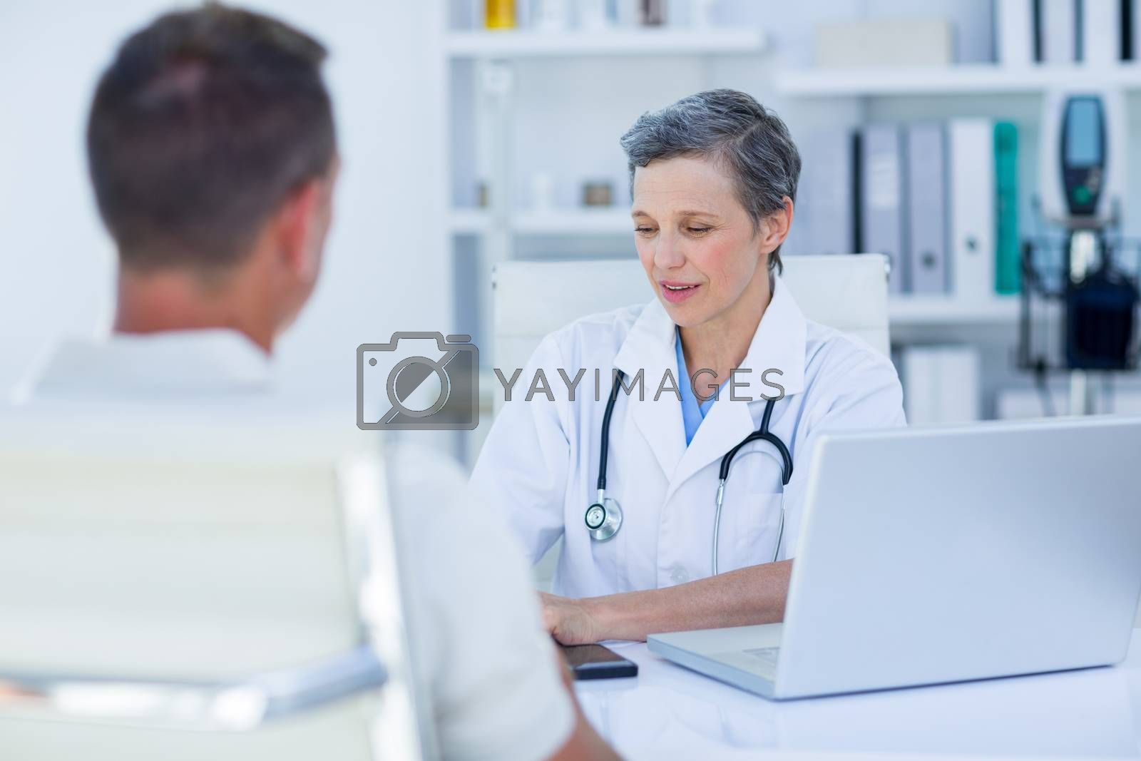 Royalty free image of Female doctor speaking with her patient  by Wavebreakmedia