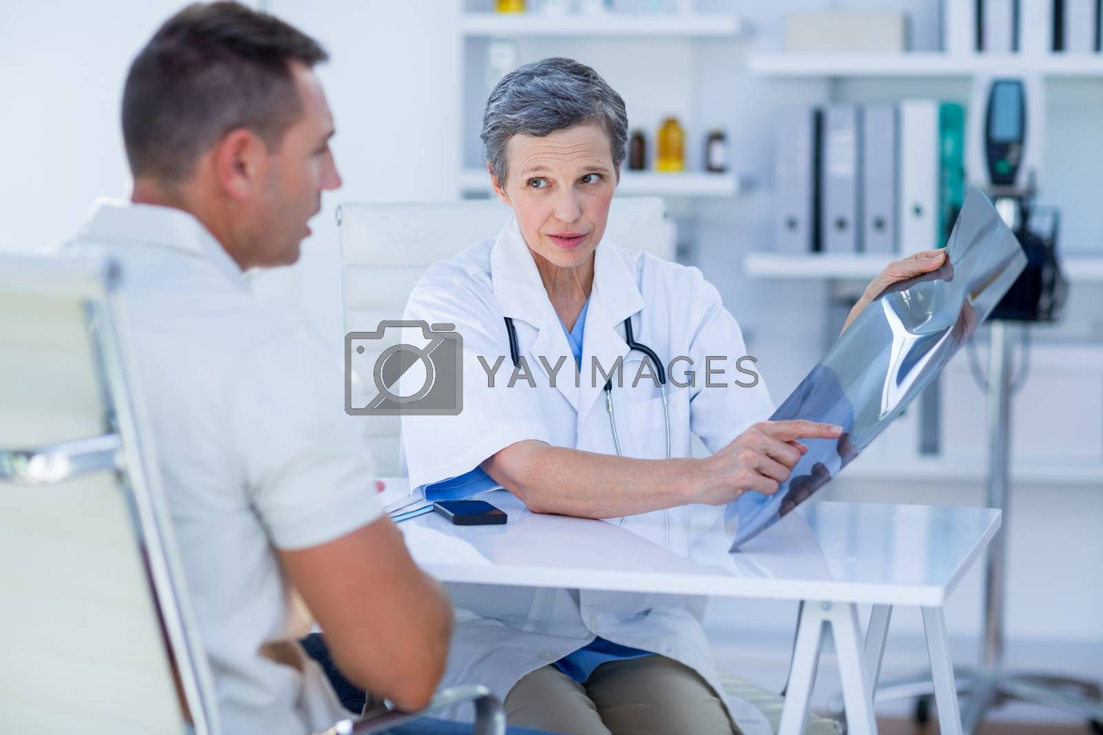 Royalty free image of Doctor showing X rays to her patient  by Wavebreakmedia