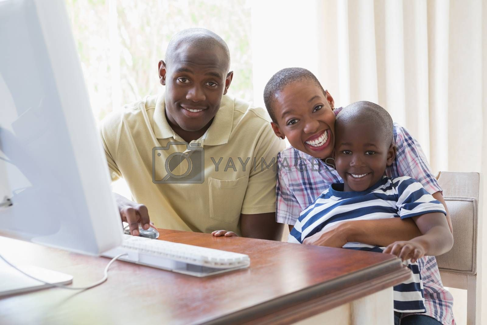 Royalty free image of Portrait of happy smiling family using computer  by Wavebreakmedia
