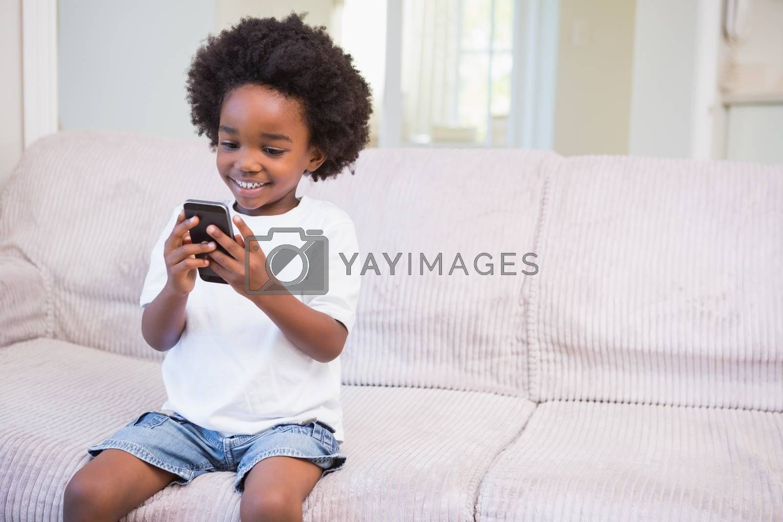 Royalty free image of A little boy using a technology by Wavebreakmedia