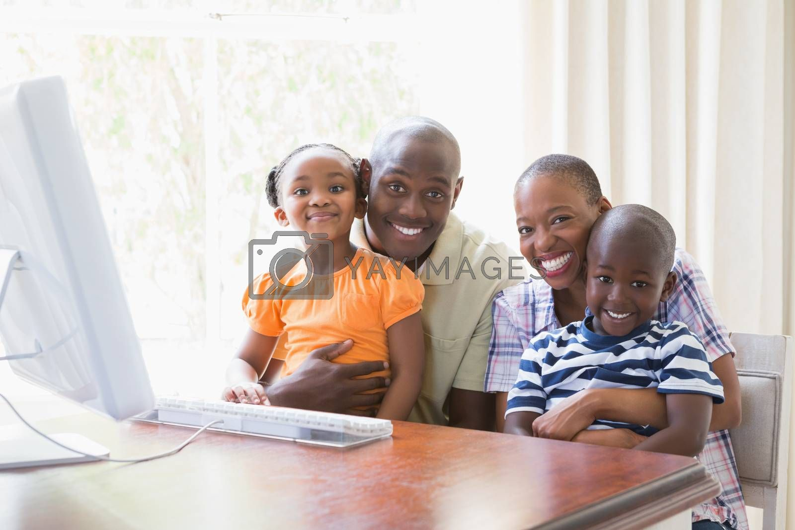 Royalty free image of Portrait happy smiling family using computer by Wavebreakmedia