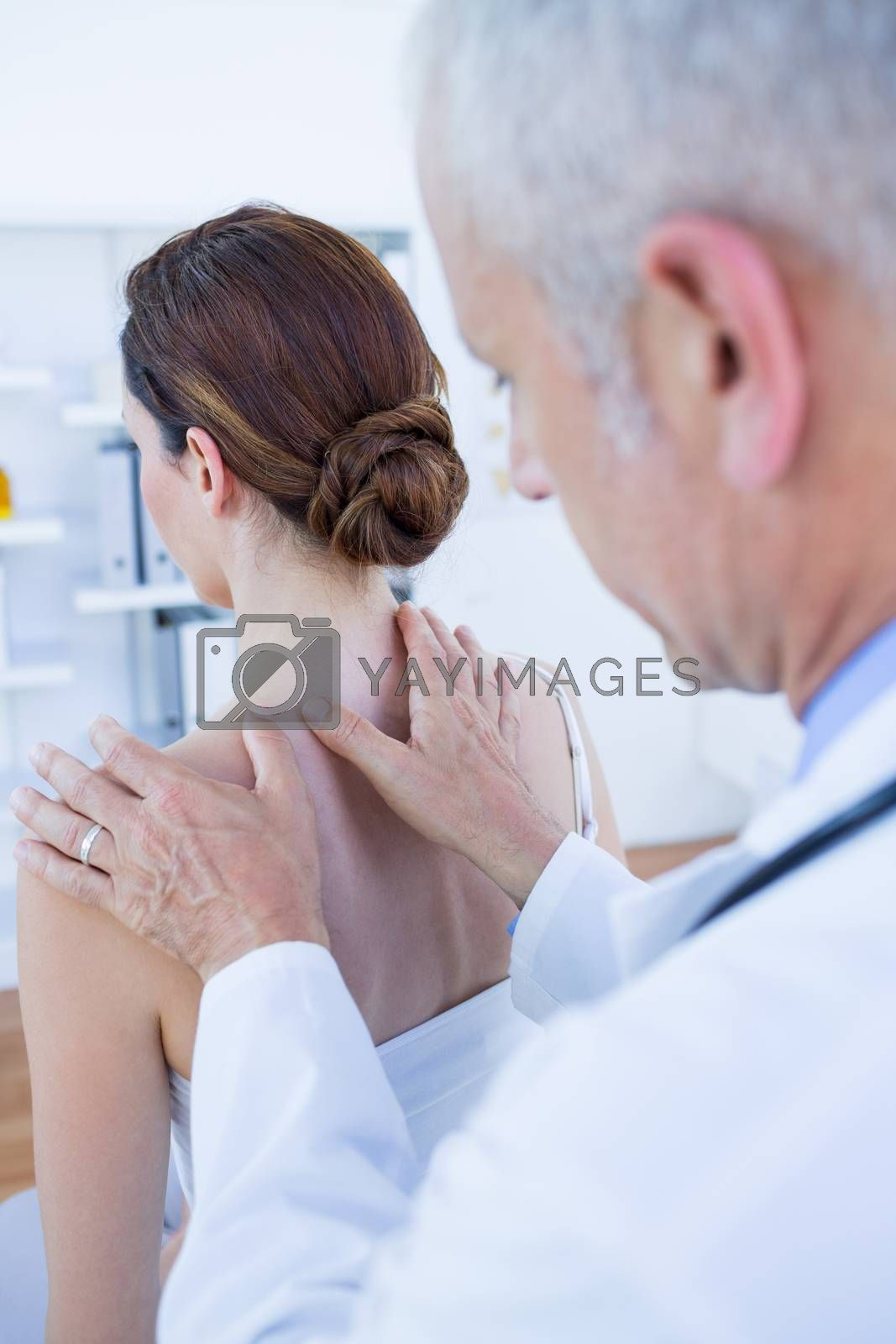 Royalty free image of Doctor doing shoulder massage to his patient by Wavebreakmedia
