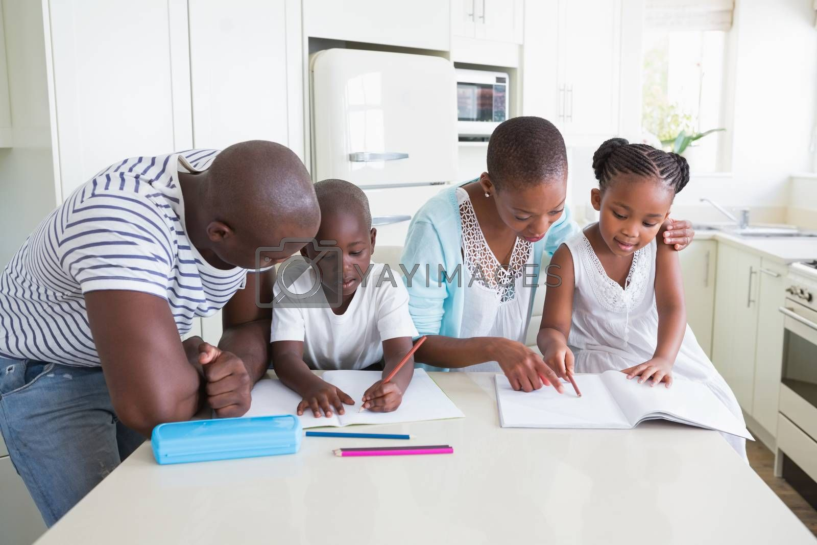 Royalty free image of A happy family working together  by Wavebreakmedia