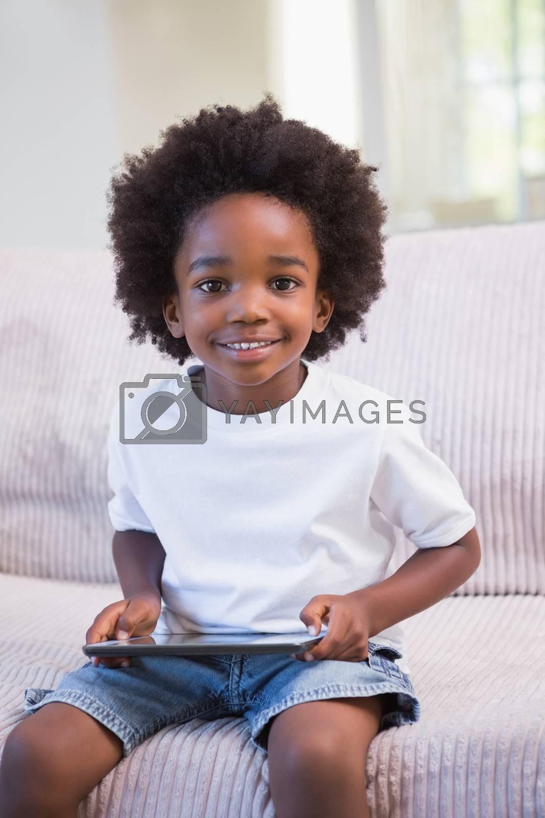 Royalty free image of Portrait of a little boy using digital tablet  by Wavebreakmedia