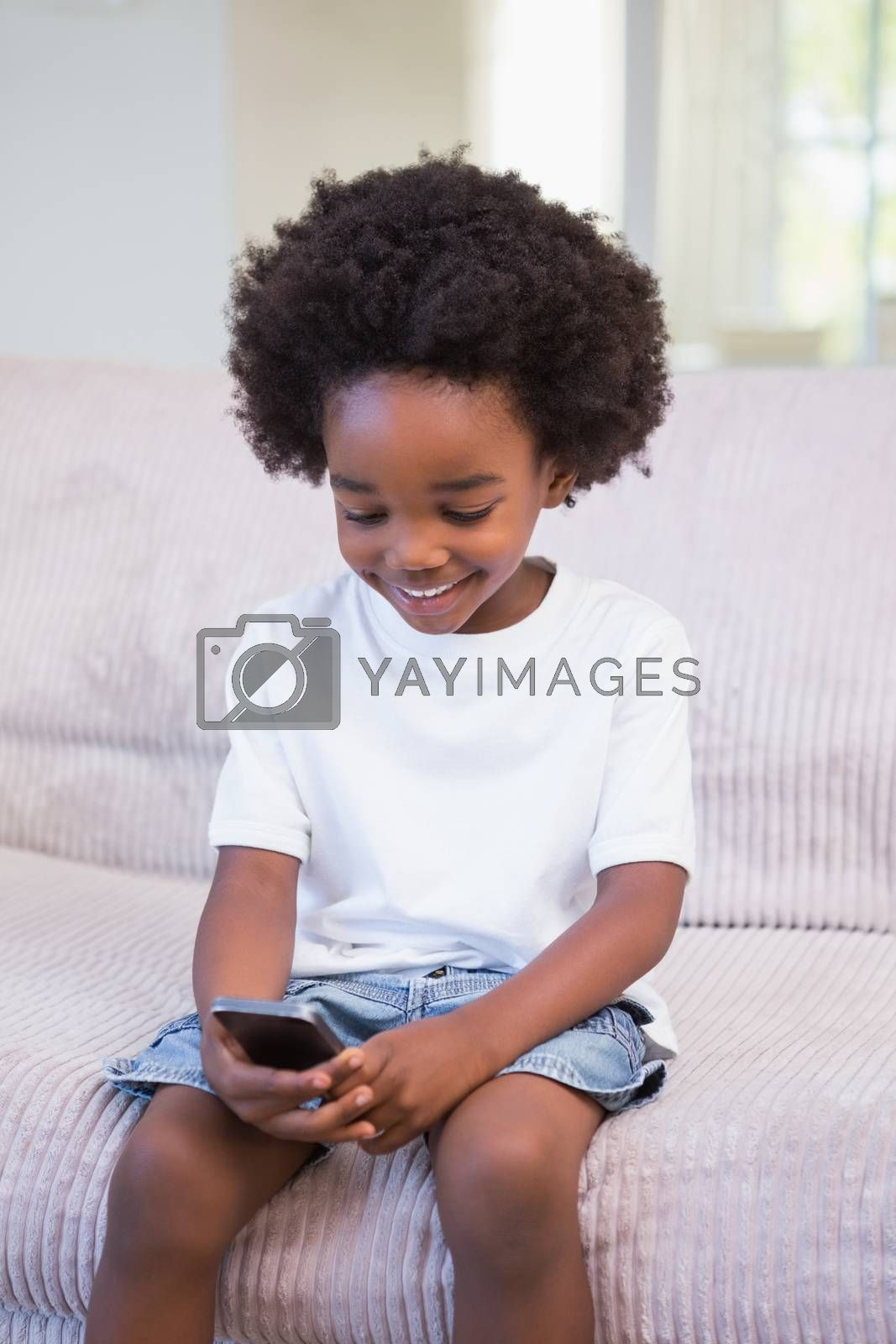 Royalty free image of Little boy using a technology by Wavebreakmedia