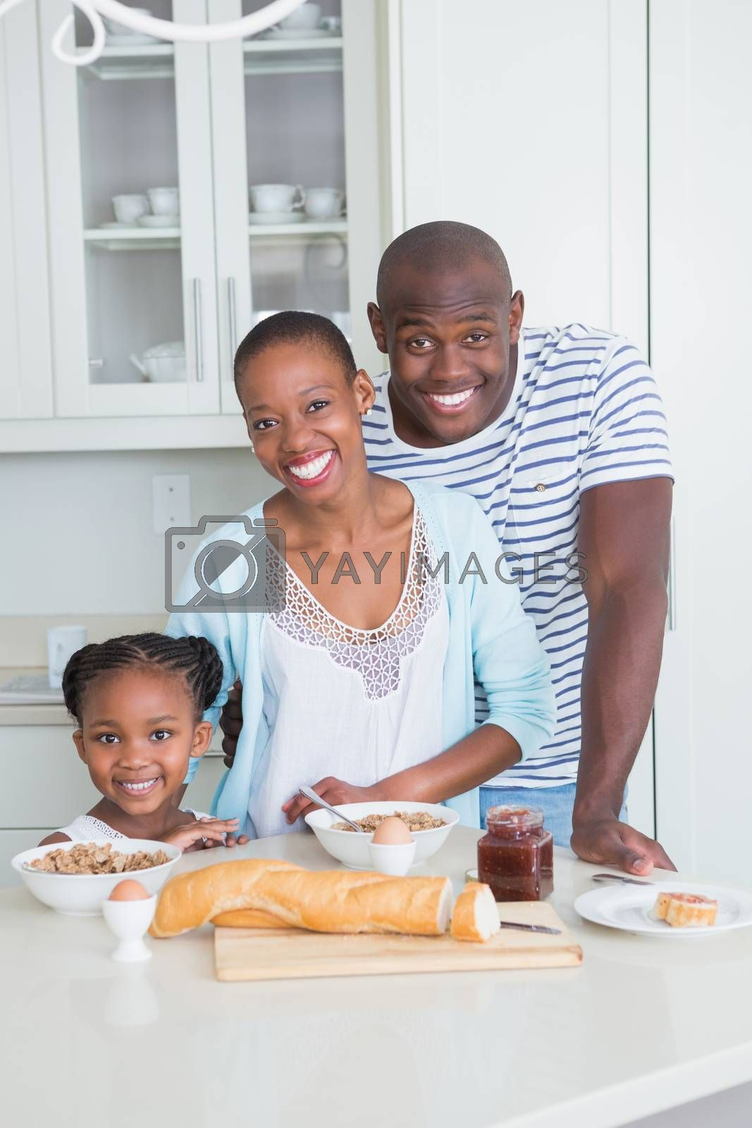 Royalty free image of Portrait of a happy family sitting and taking breakfast by Wavebreakmedia