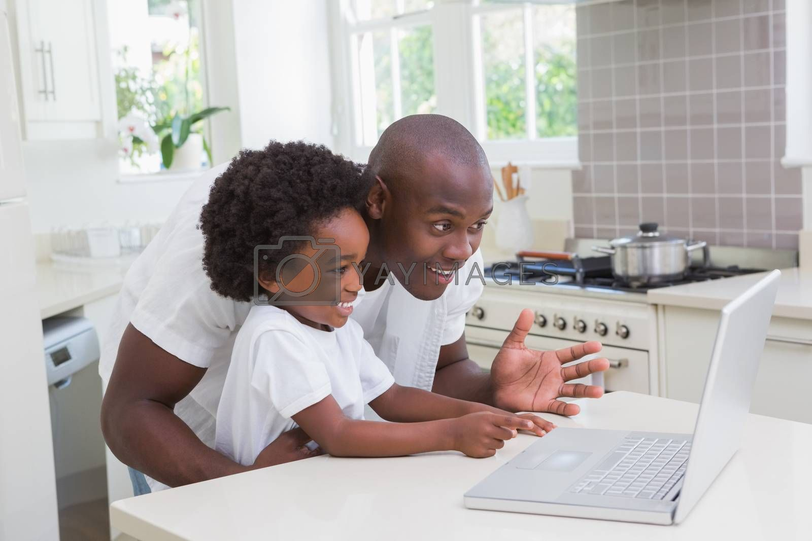 Royalty free image of Father and son using laptop on the couch by Wavebreakmedia