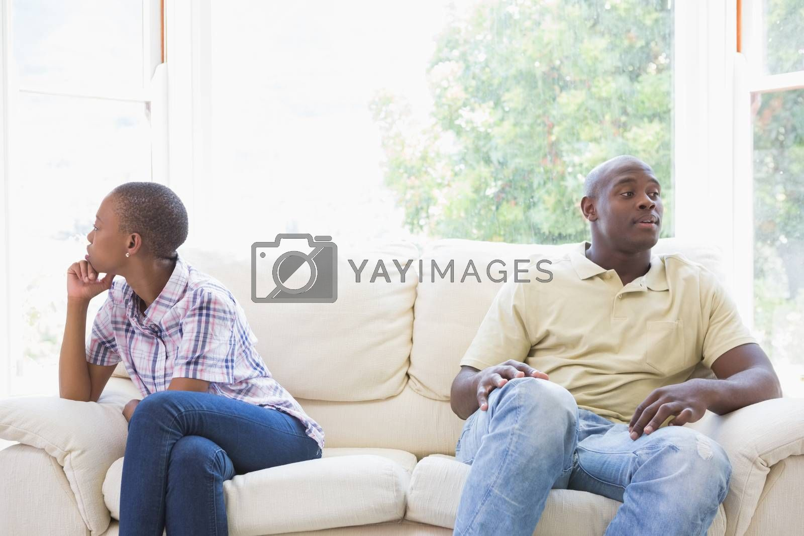 Royalty free image of A dispute between a couple sitting on the couch by Wavebreakmedia
