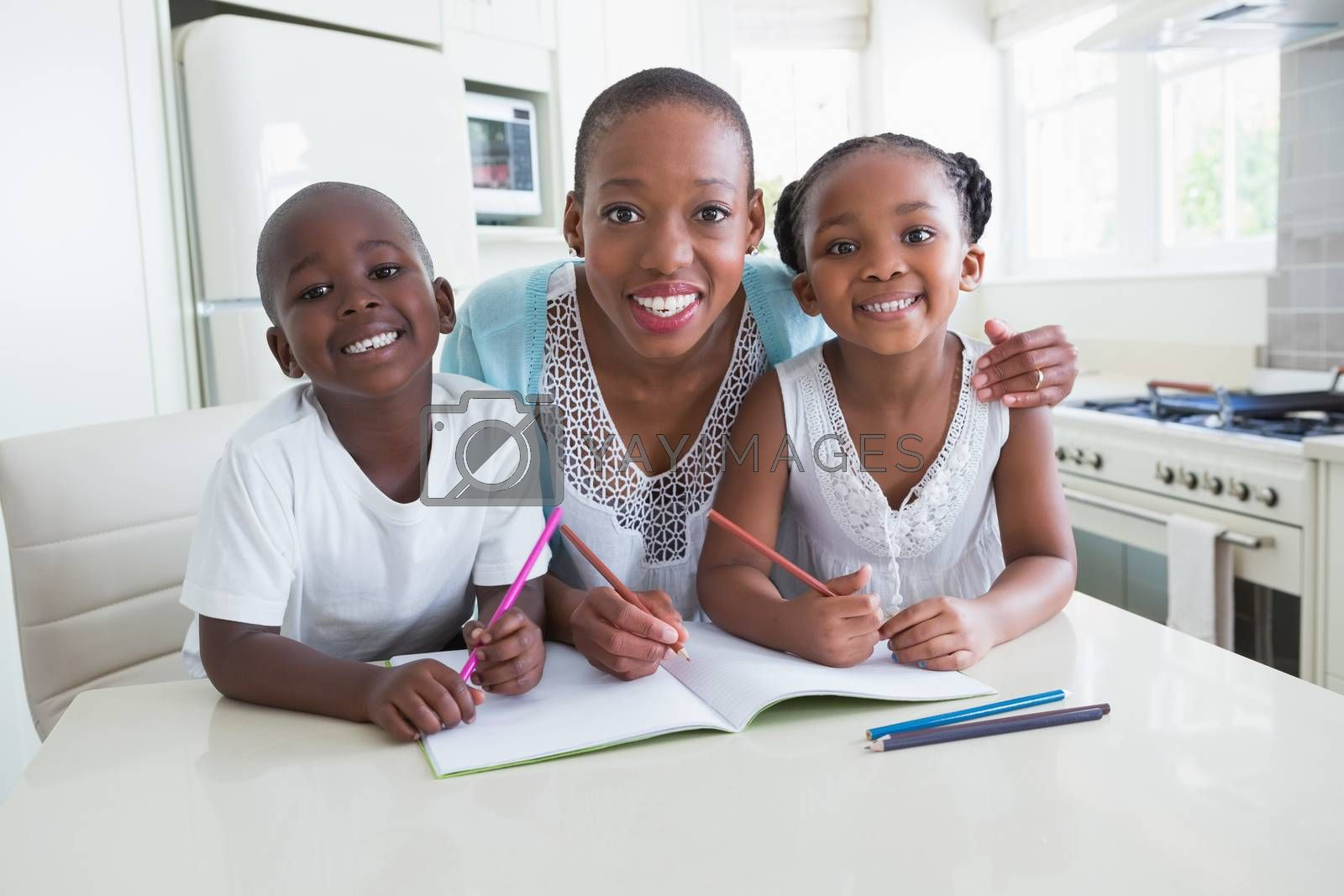 Royalty free image of Portrait of a happy family working on the table  by Wavebreakmedia