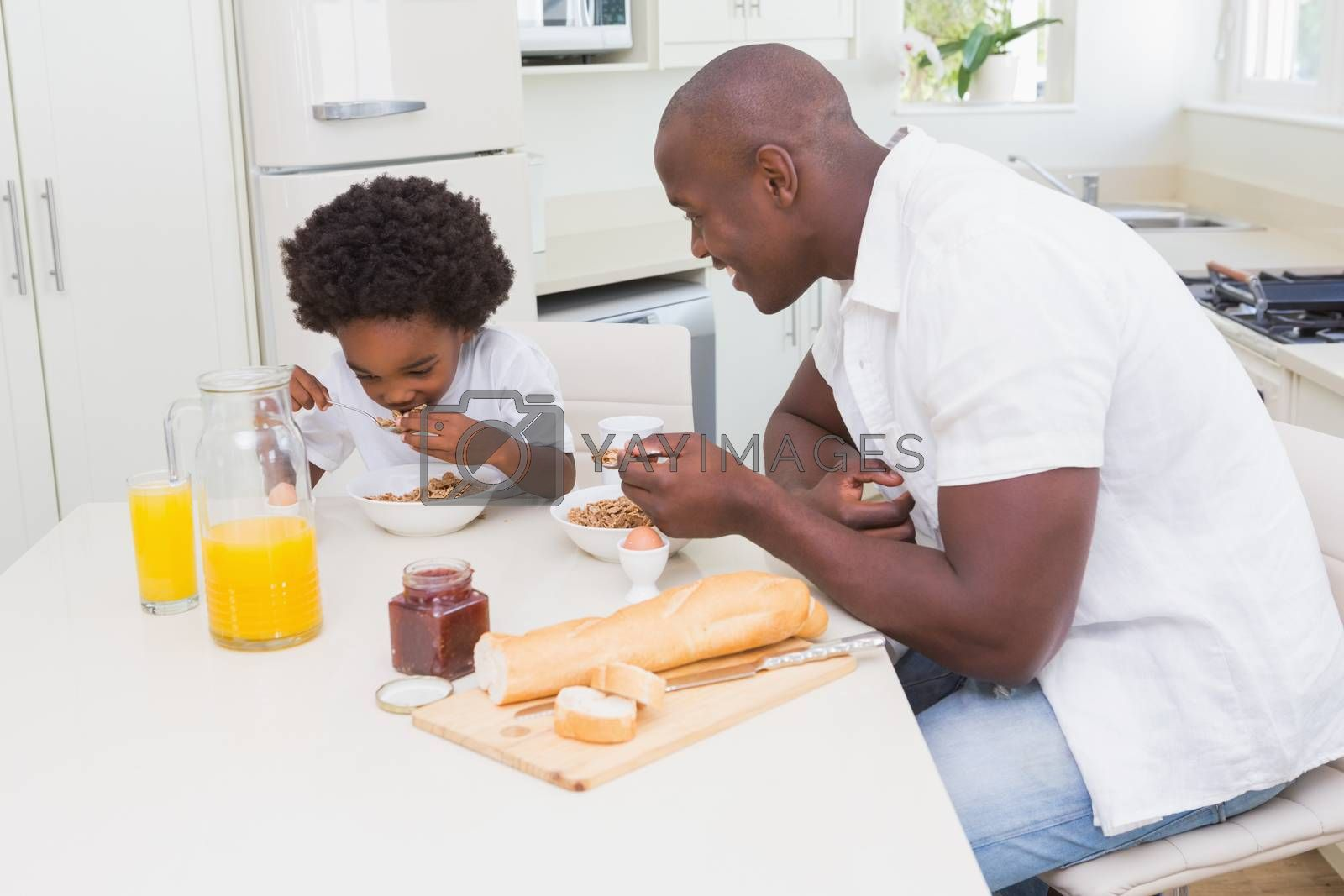Royalty free image of Father and son eating a breakfast by Wavebreakmedia