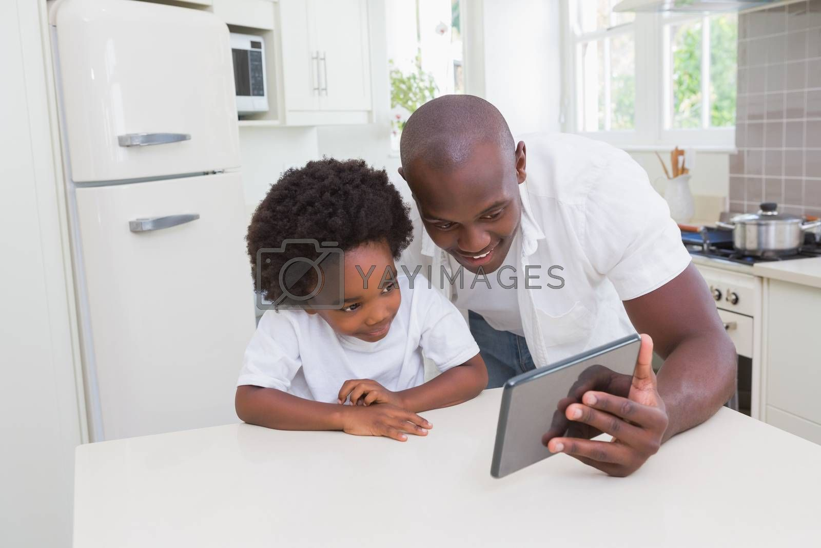 Royalty free image of Father and son using digital tablet by Wavebreakmedia