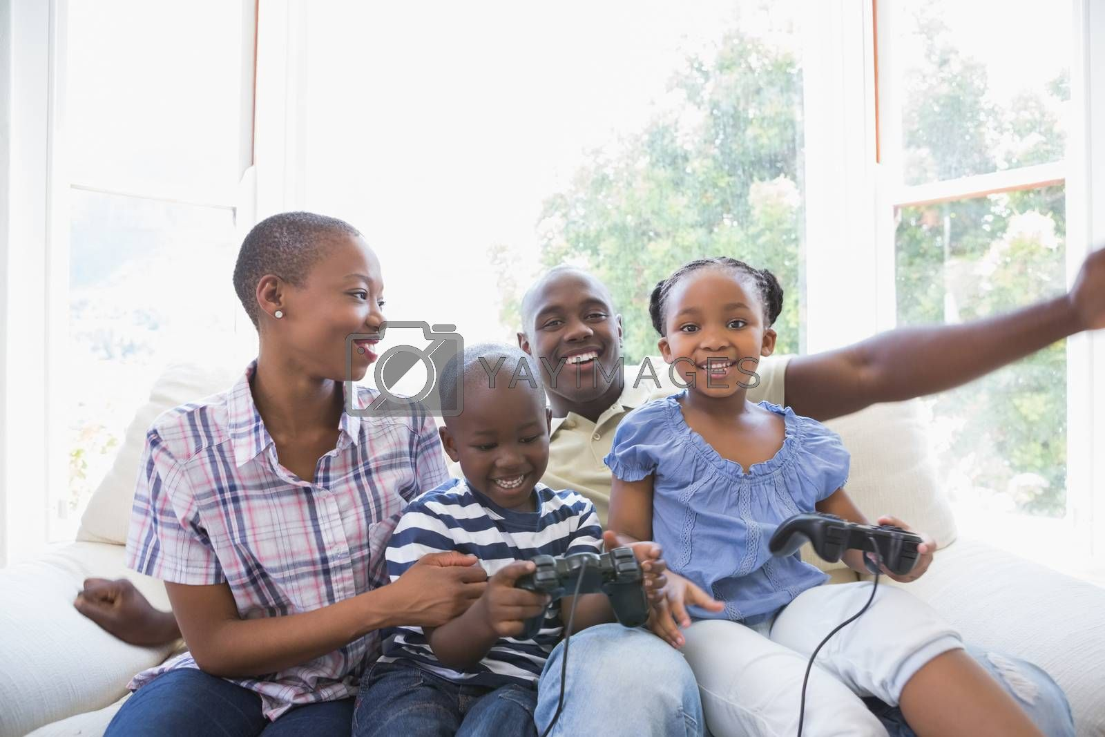 Royalty free image of Happy smiling family playing video games together by Wavebreakmedia