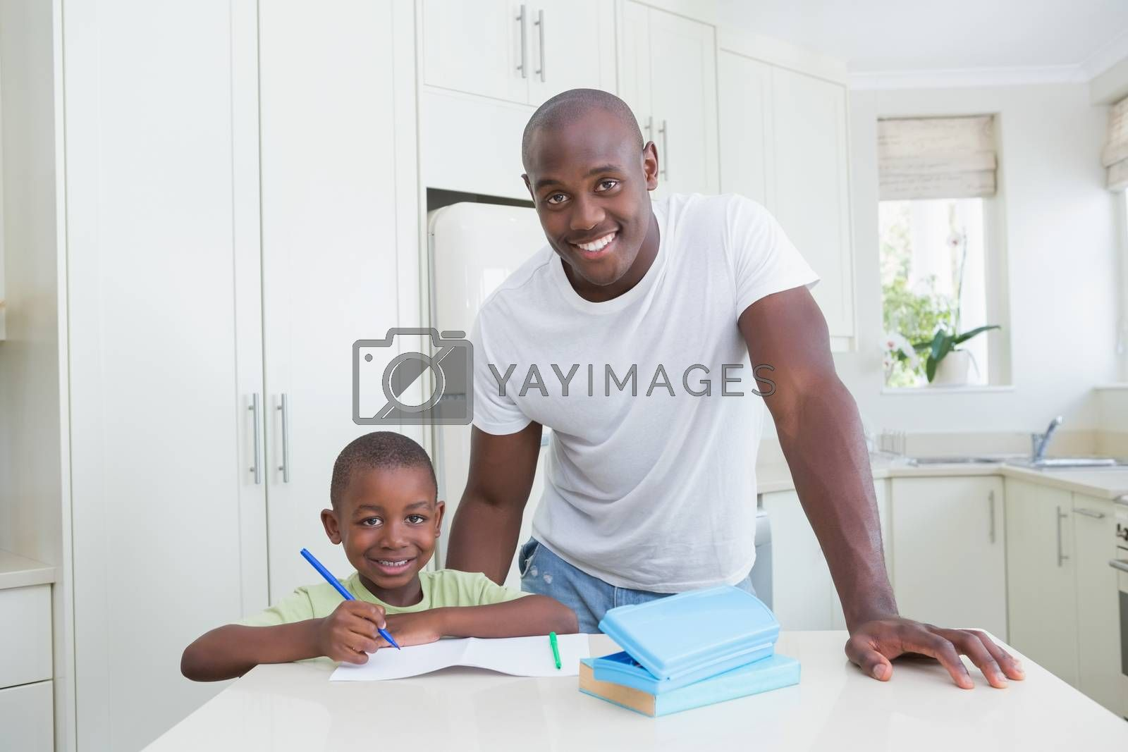 Royalty free image of Portrait of a father working with his son  by Wavebreakmedia