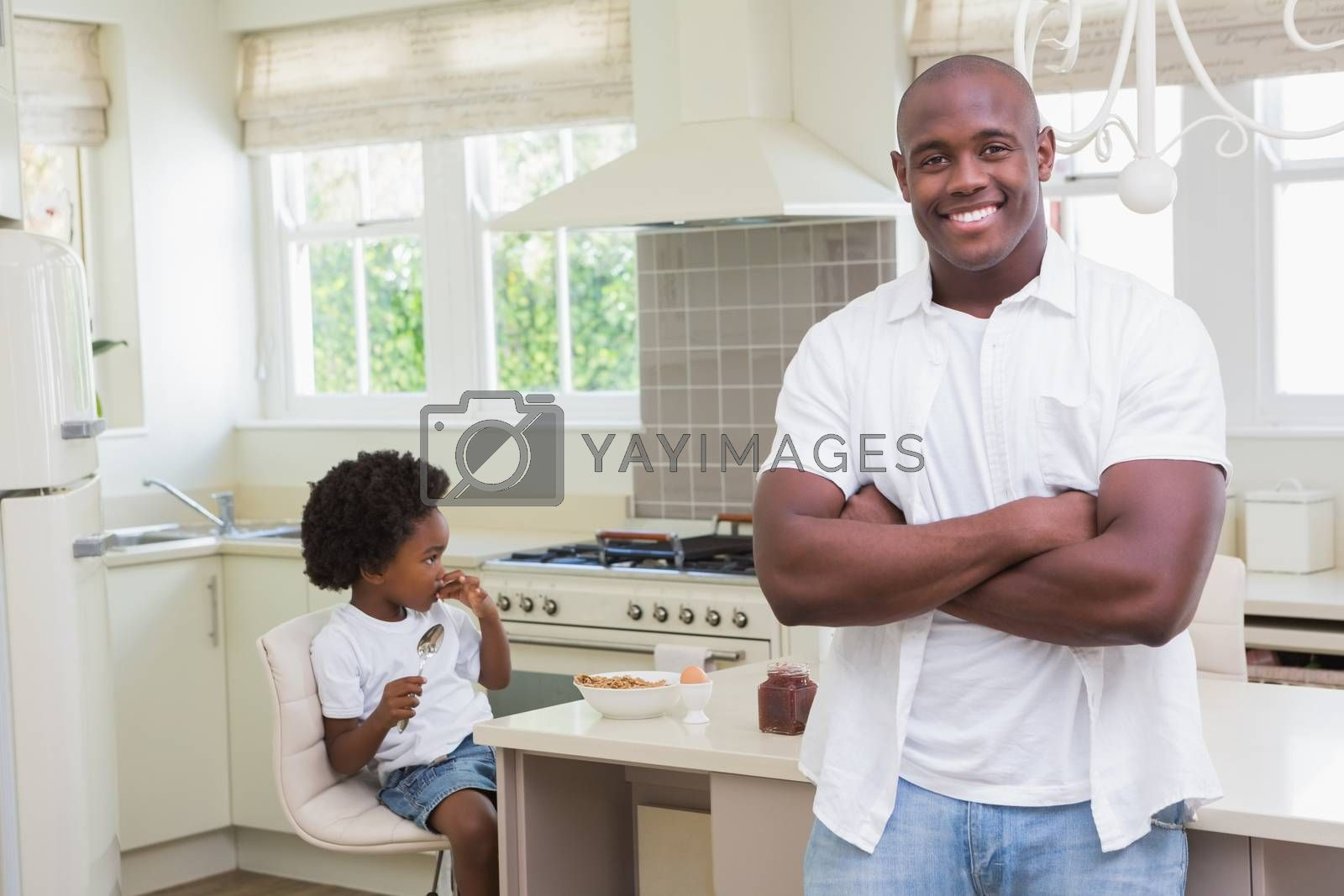Royalty free image of Portrait of a father and son eating breakfast  by Wavebreakmedia