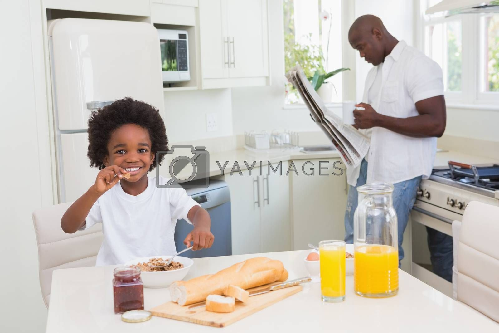 Royalty free image of Smiling father and son taking a breakfast by Wavebreakmedia