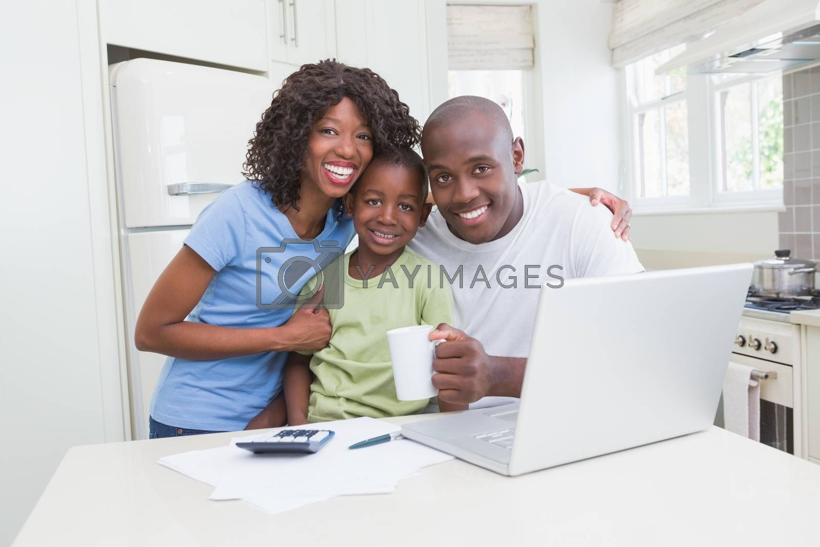 Royalty free image of Portrait of a happy smiling family using computer  by Wavebreakmedia