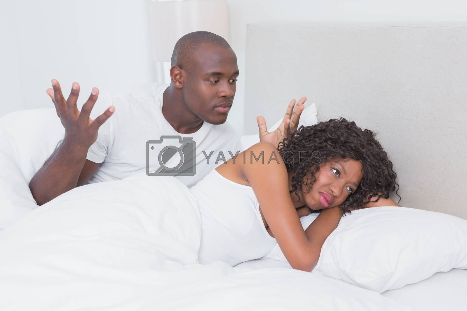 Royalty free image of Dispute between a couple in bed together by Wavebreakmedia