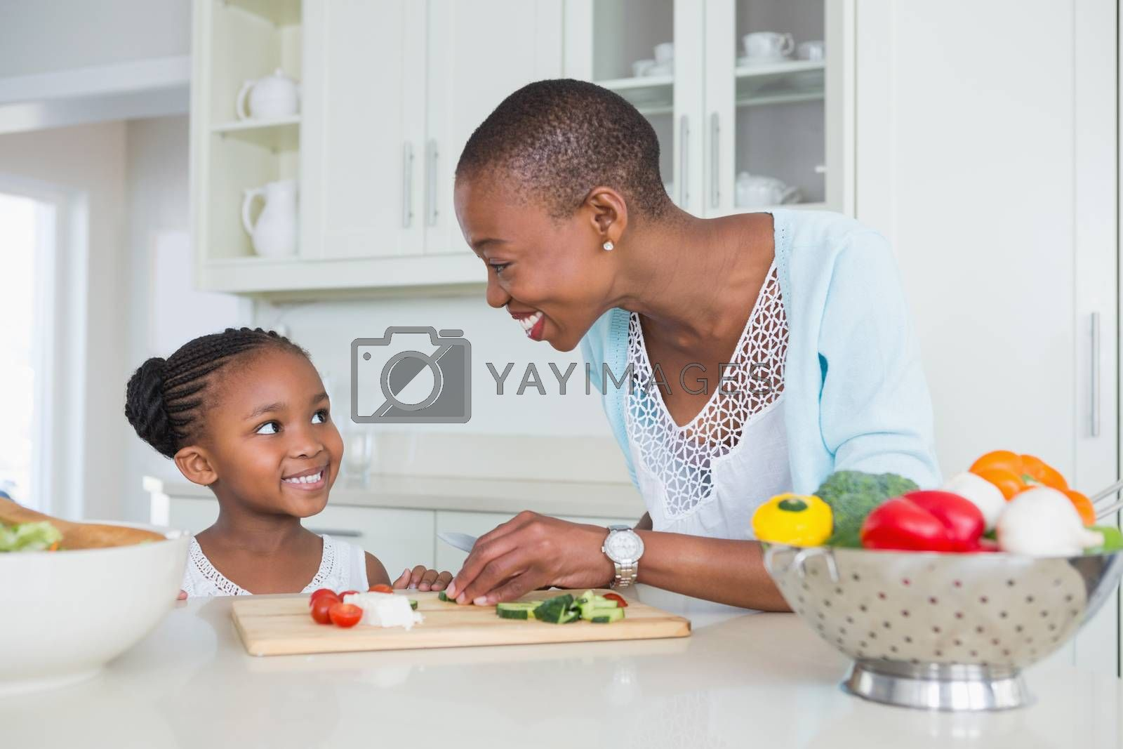 Royalty free image of Mother and daughter making a salad together  by Wavebreakmedia