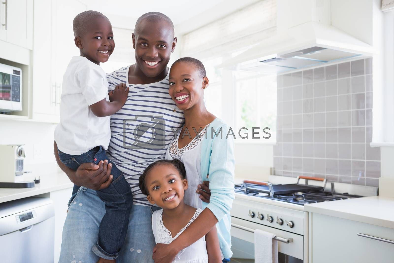 Royalty free image of Portrait of a happy family looking at the camera  by Wavebreakmedia