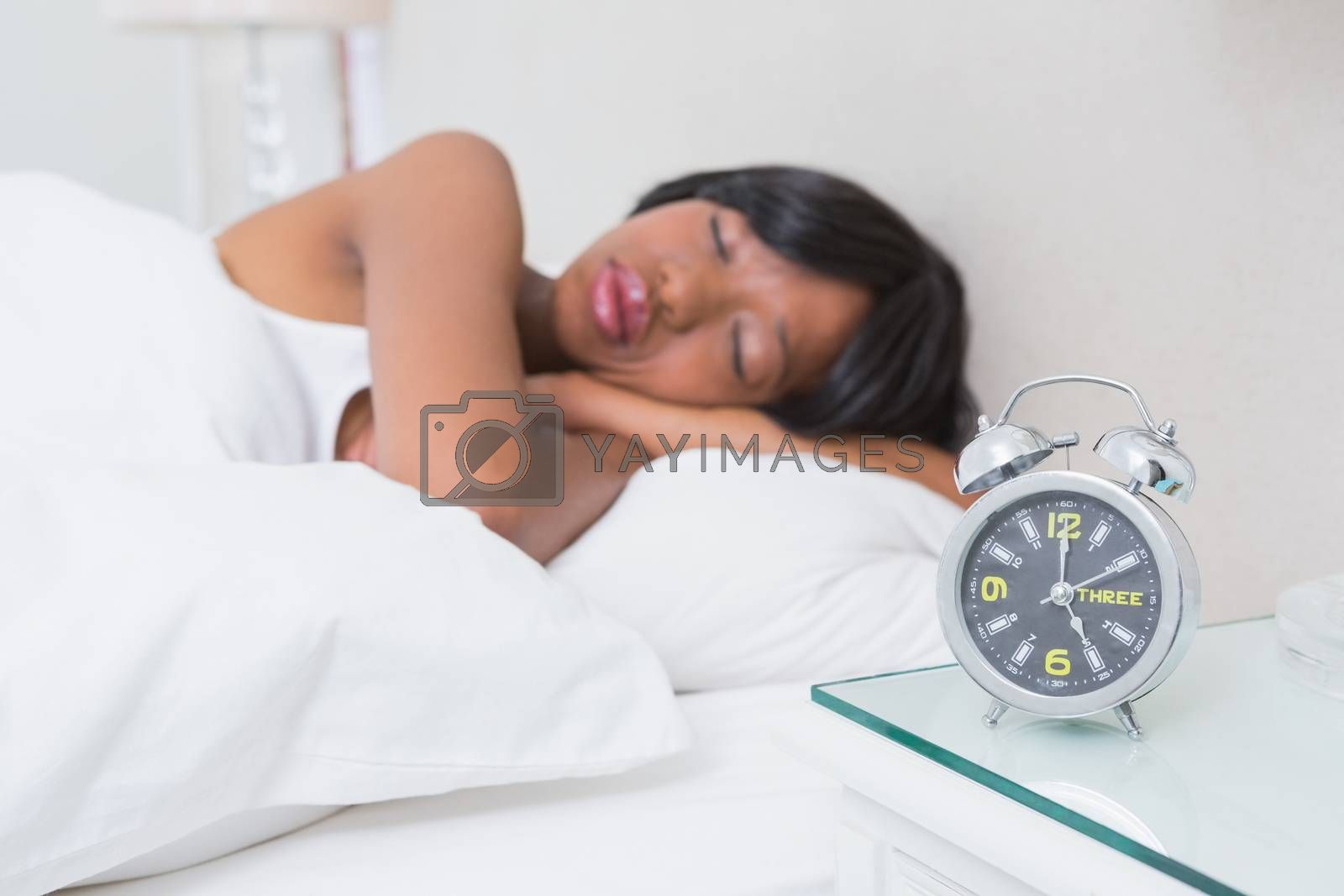 Royalty free image of Pretty brunette sleeping in her bed  by Wavebreakmedia