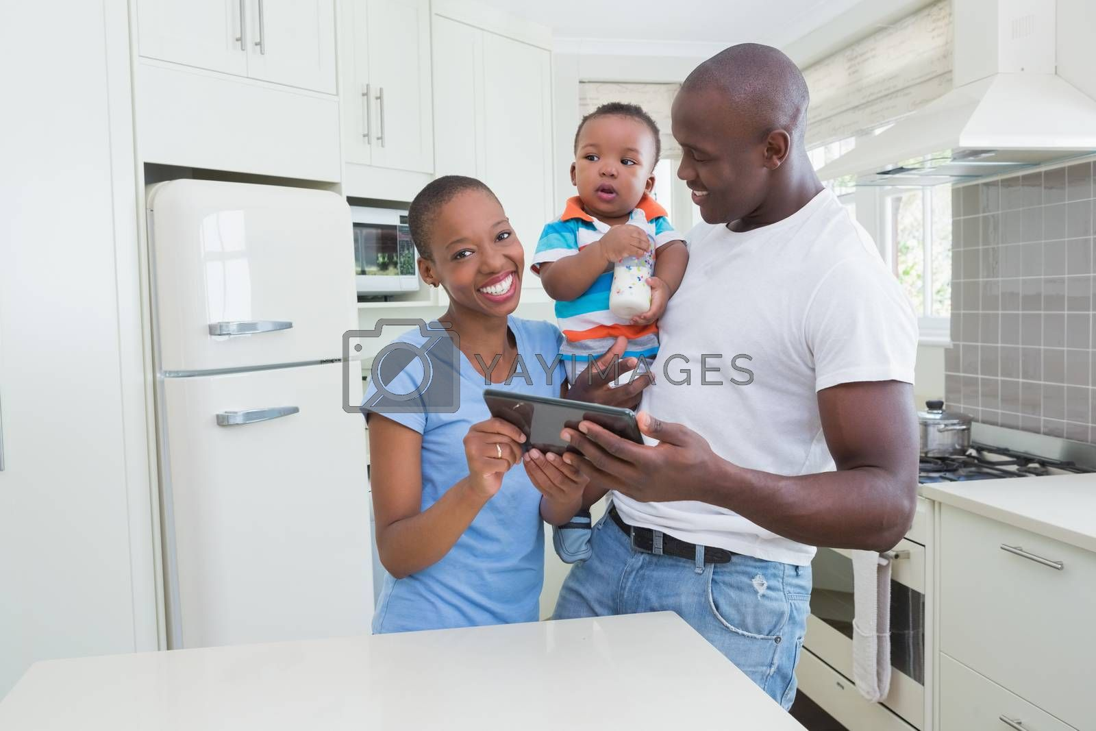 Royalty free image of Happy smiling couple with his babyboy using digital tablet  by Wavebreakmedia