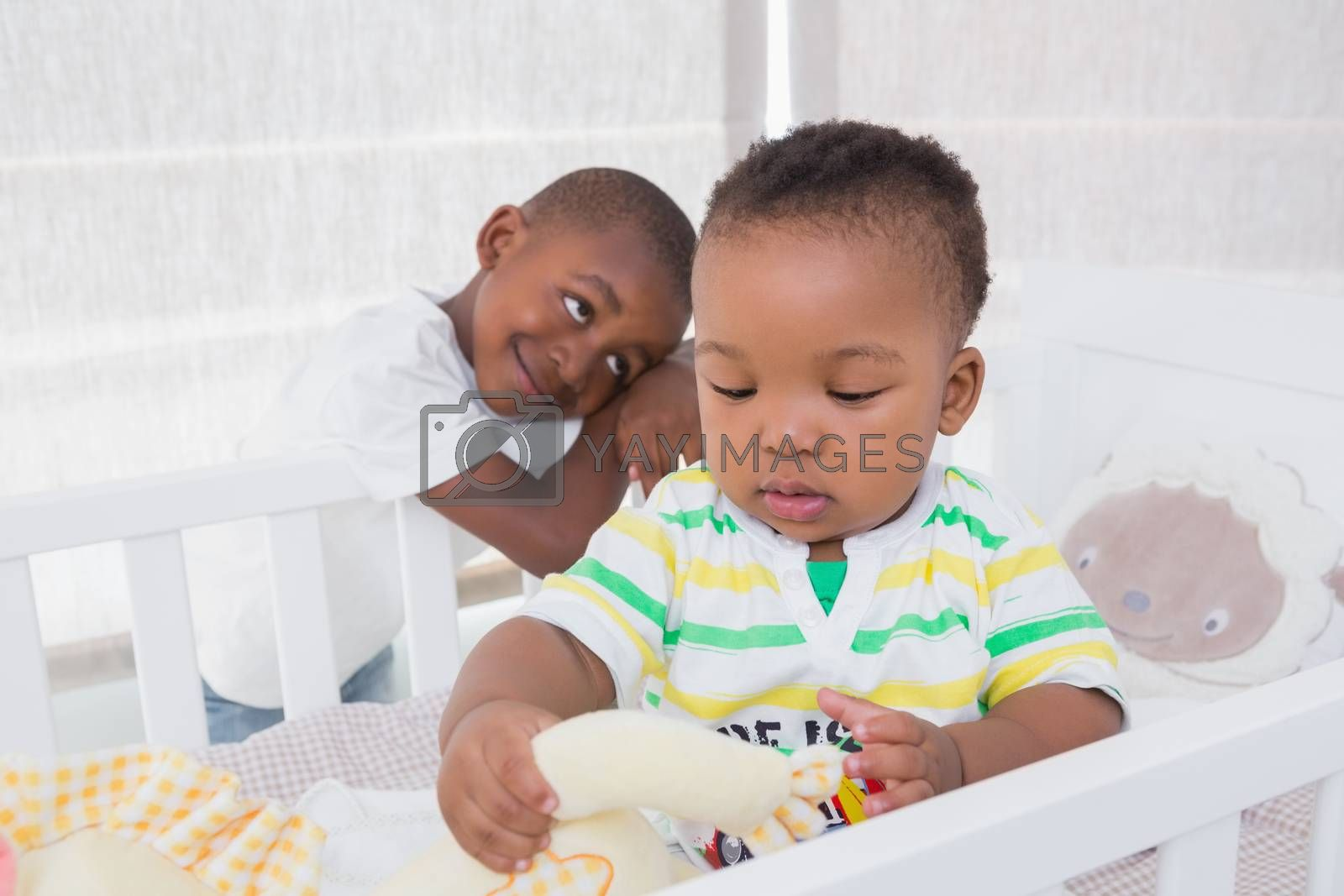 Royalty free image of Babyboy and his brother in babyroom  by Wavebreakmedia