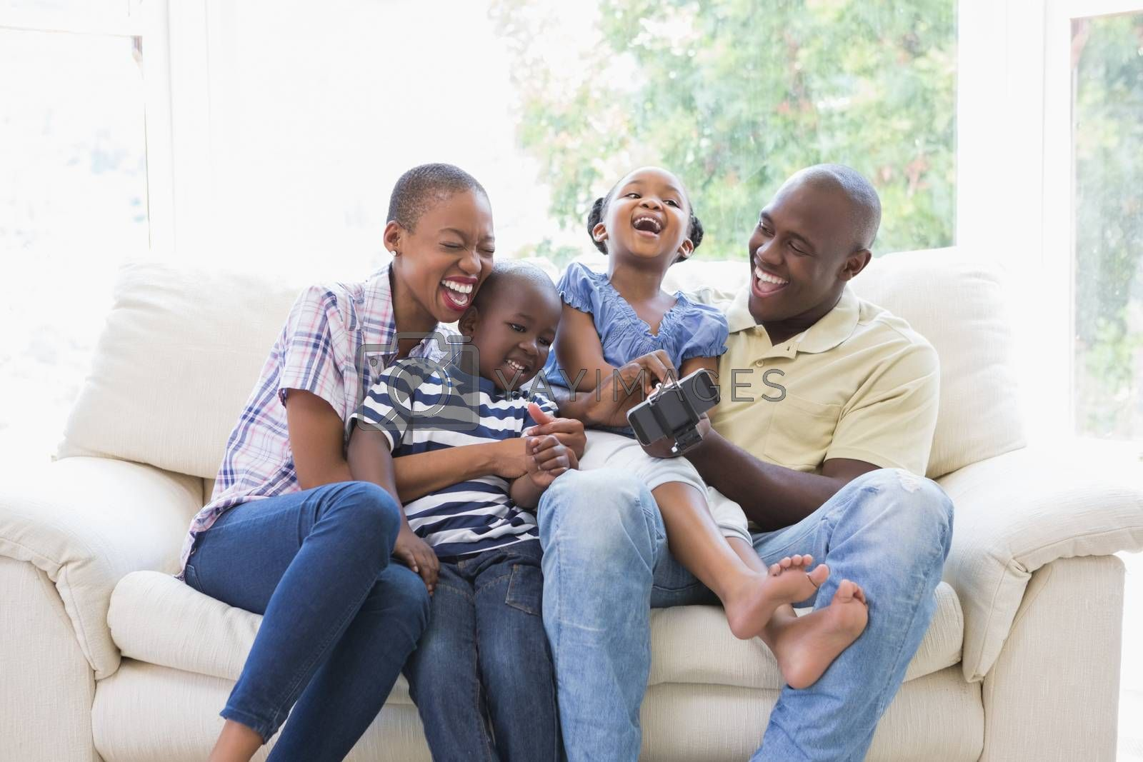 Royalty free image of Happy smiling family on the couch  by Wavebreakmedia