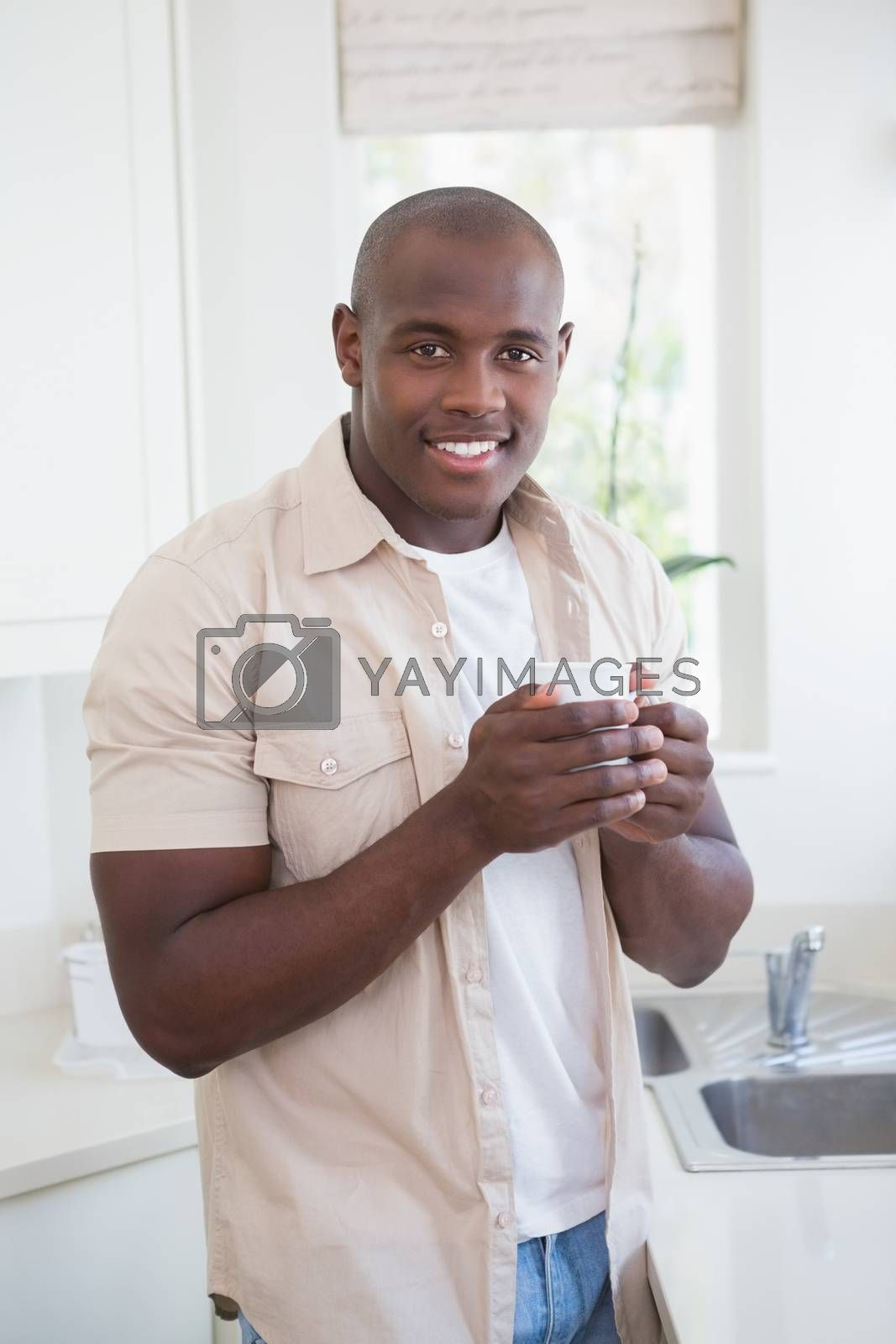 Royalty free image of Smiling of a man  drinking tea  by Wavebreakmedia