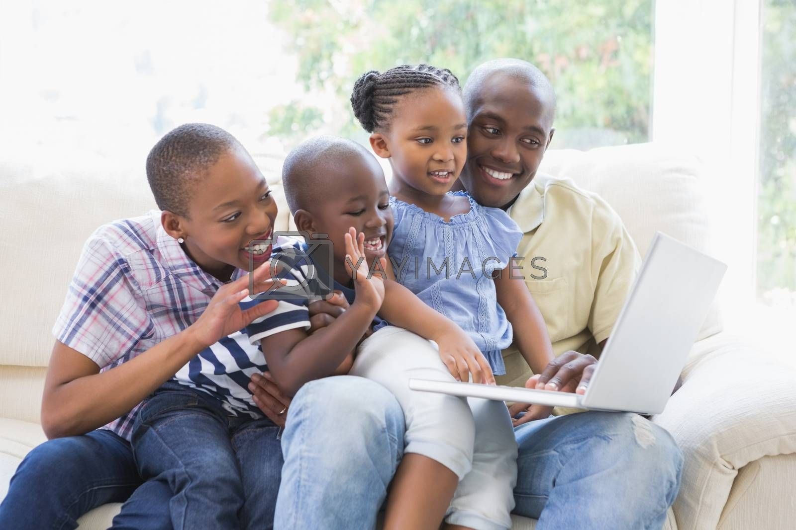 Royalty free image of Happy family on the couch chatting with laptop  by Wavebreakmedia