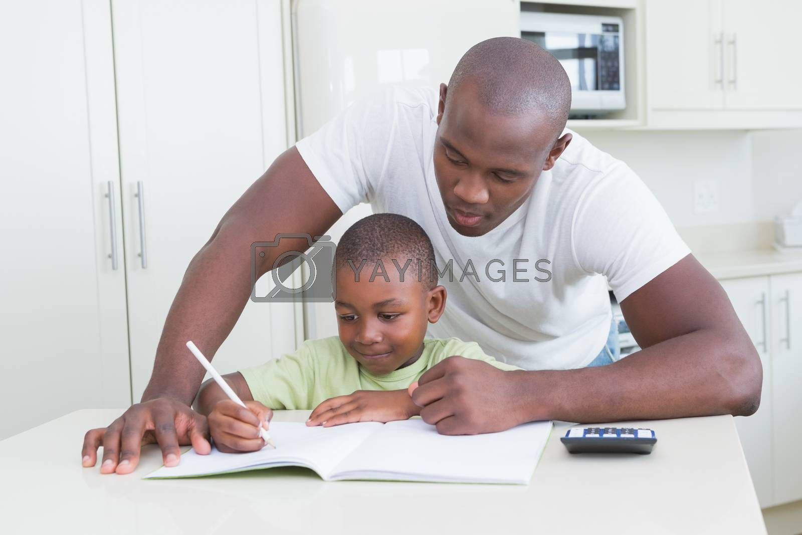 Royalty free image of Happy smiling father working with his son  by Wavebreakmedia